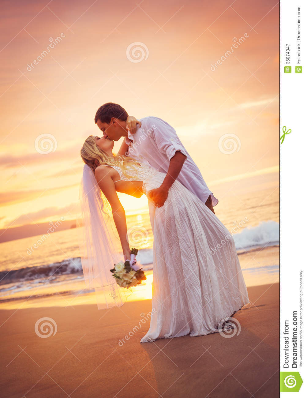 Bride And Groom Kissing At Sunset On A Beautiful Tropical