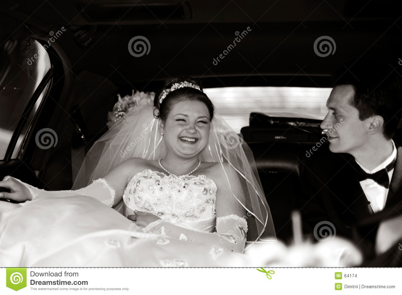 Bride and Groom in a limousine