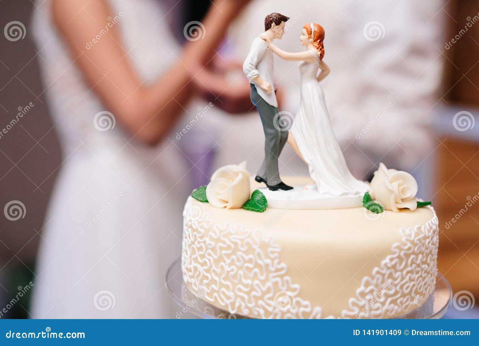 Bride and groom marzipan figures on the wedding cake