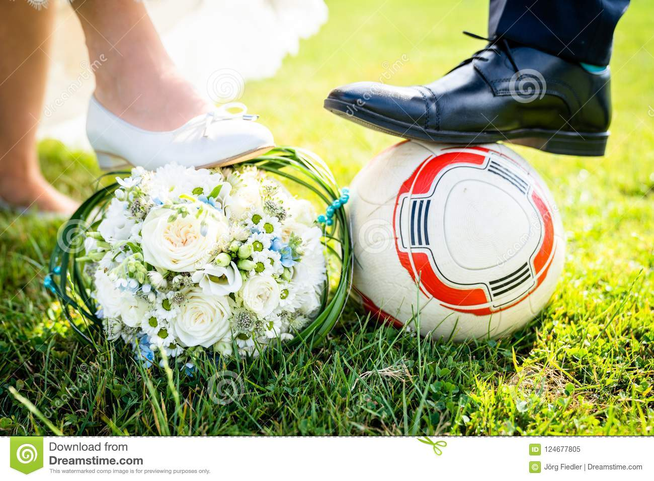 Bride And Groom Put Their Feet On The Football Stock Image Image