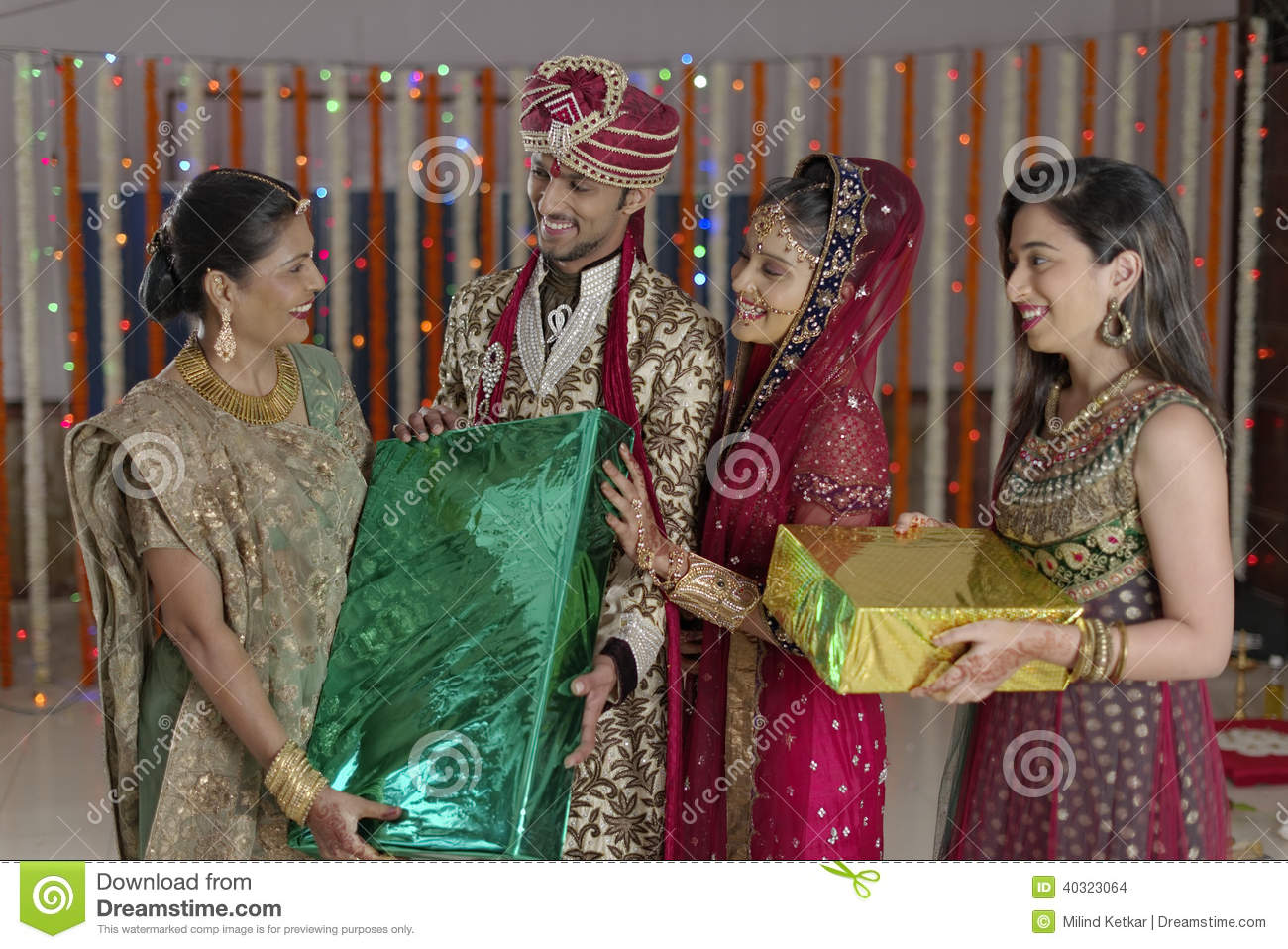 Wedding Gifts For India Couples : Bride And Groom Receiving Gifts From Relatives. Stock PhotoImage ...