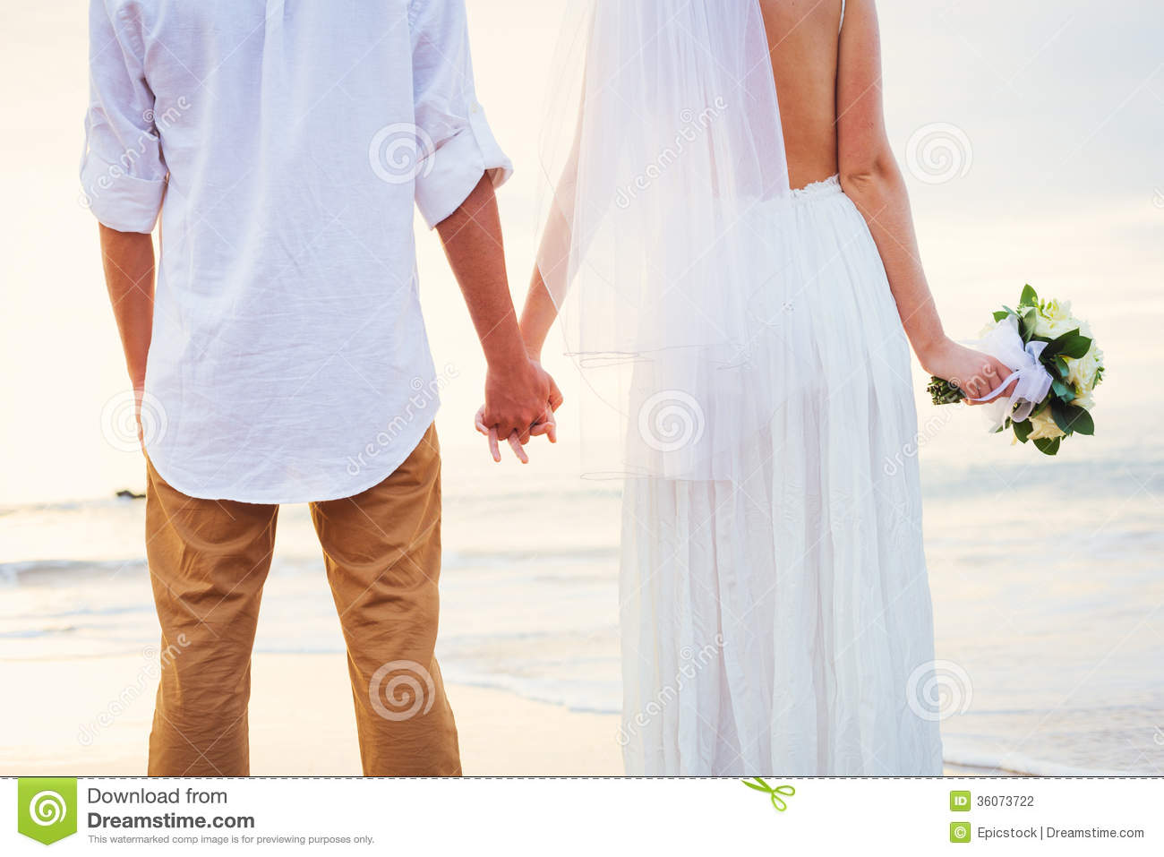 Bride And Groom Romantic Newly Married Couple Holding Hands Just