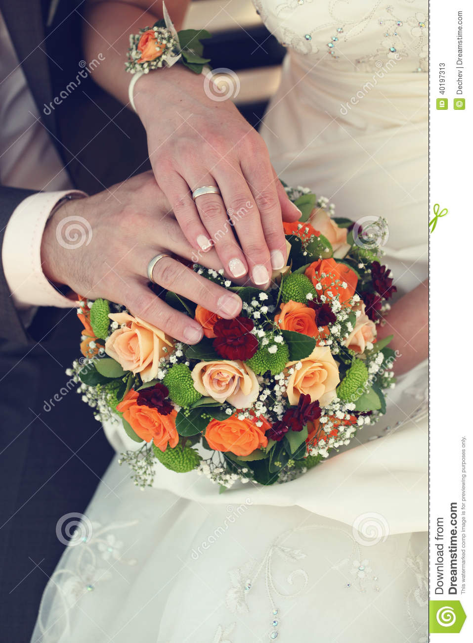 Bride And Groom Wedding Rings: Bride And Groom's Hands With Wedding Rings And Bouquet