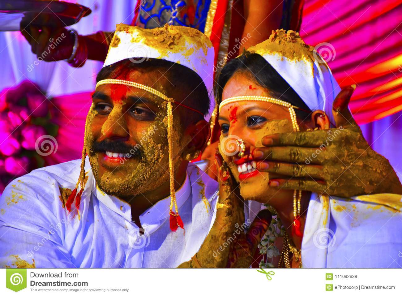 Bride and groom at turmeric ceremony at Indian wedding