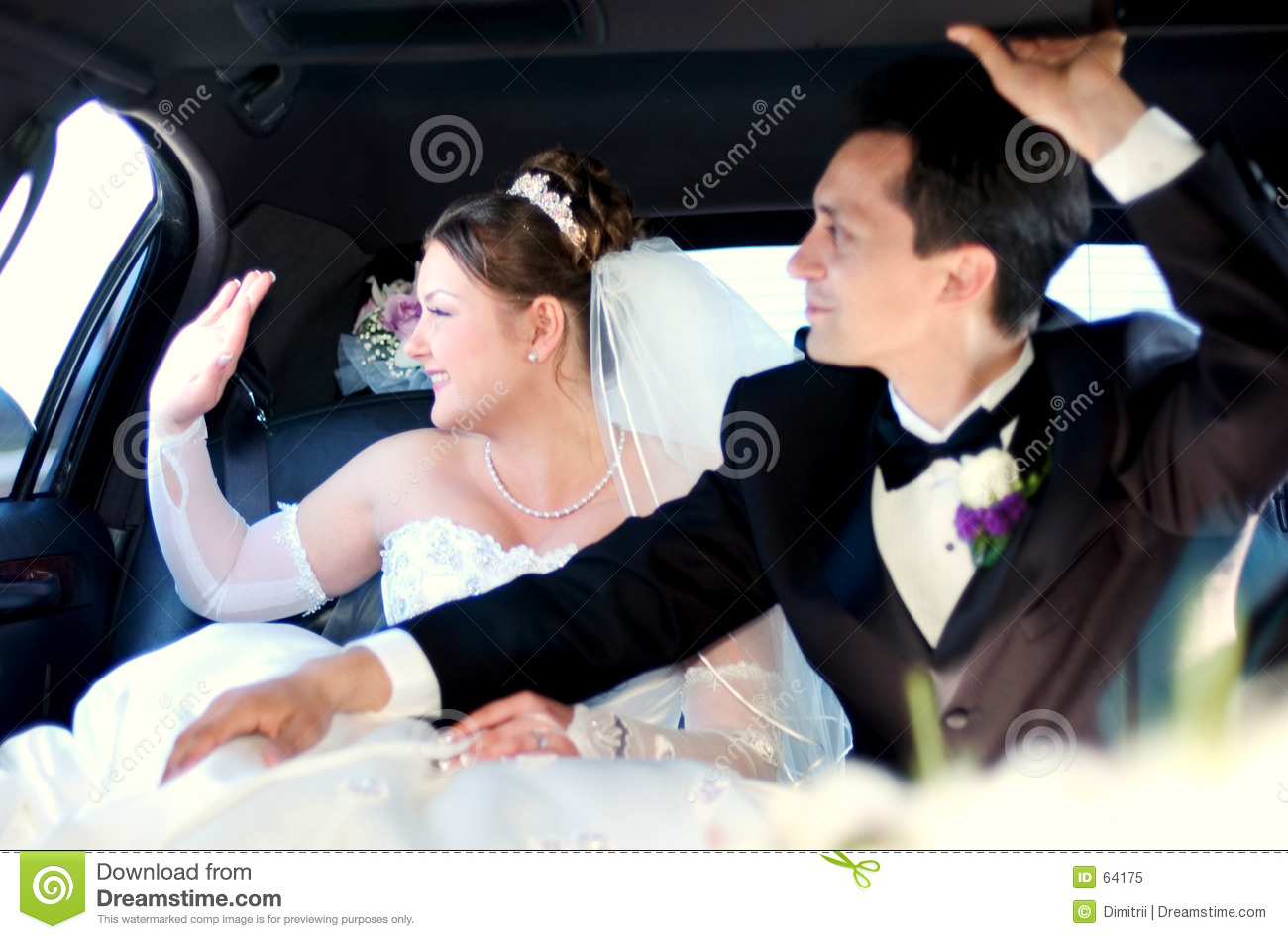 Bride and Groom waiving to the guests