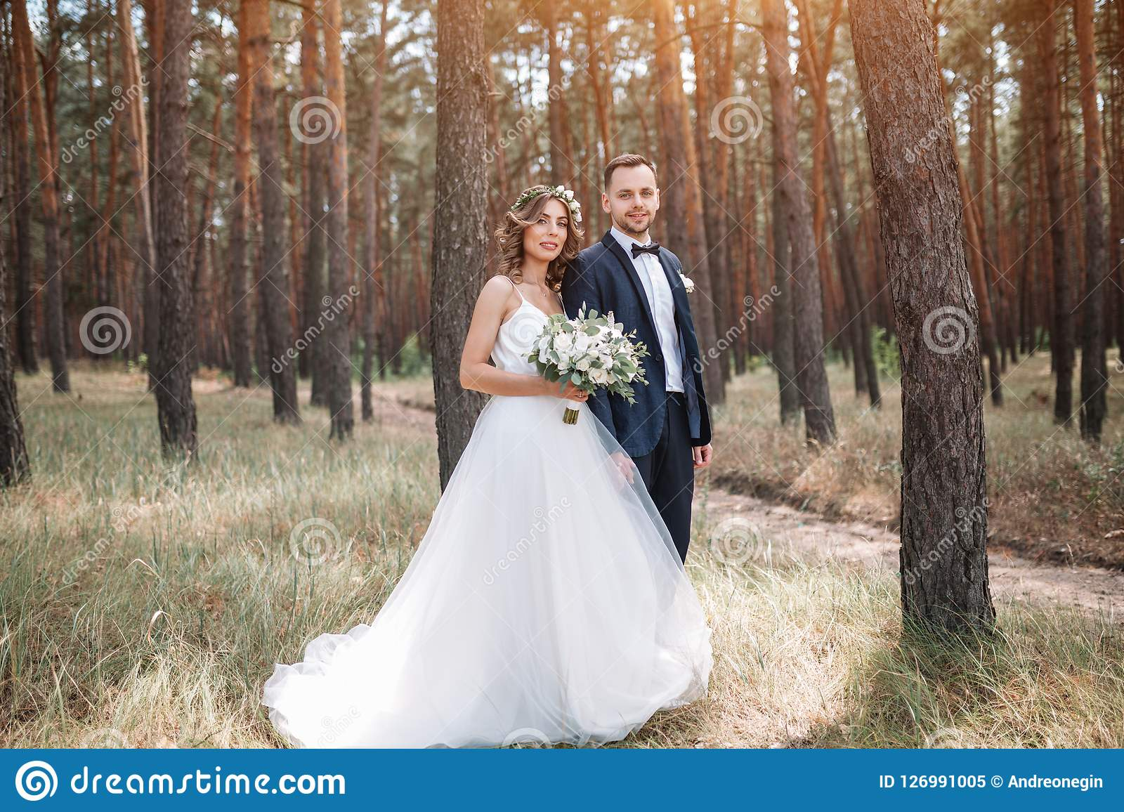Bride And Groom At Wedding Day Walking Outdoors On Summer