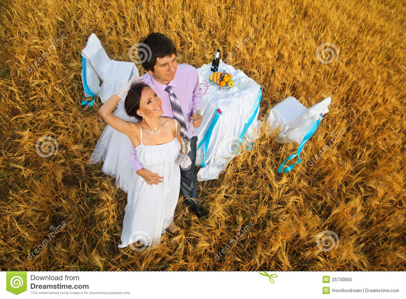 Bride and groom on the wheat field