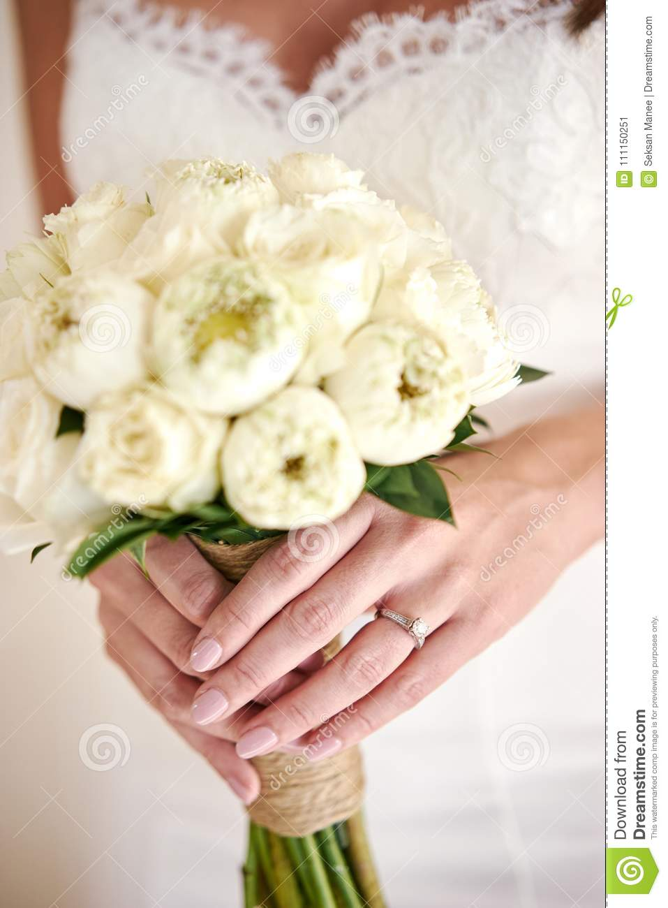 The Bride Hand With Wedding Ring, Holding The White Cream Lotus And ...