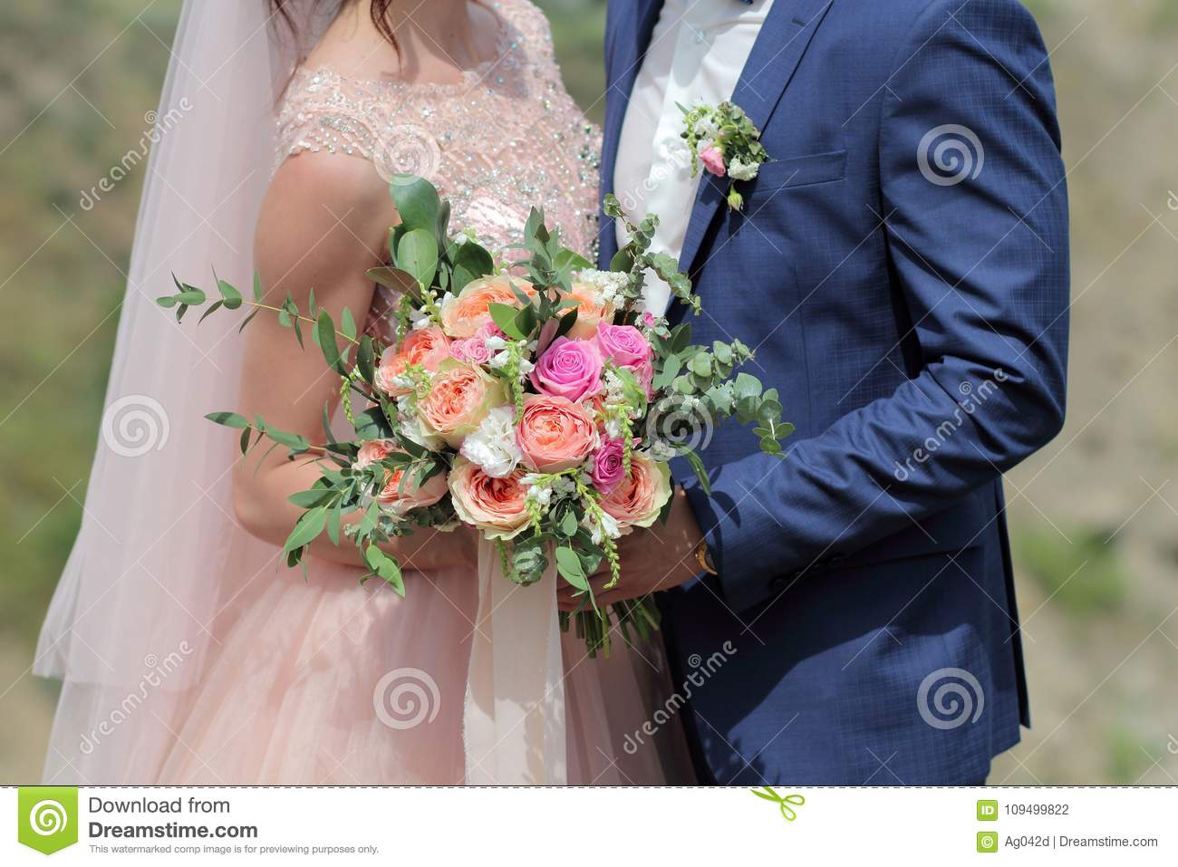 Bride Holding A Beautiful Bridal Bouquet. Wedding Bouquet Of Peach ...
