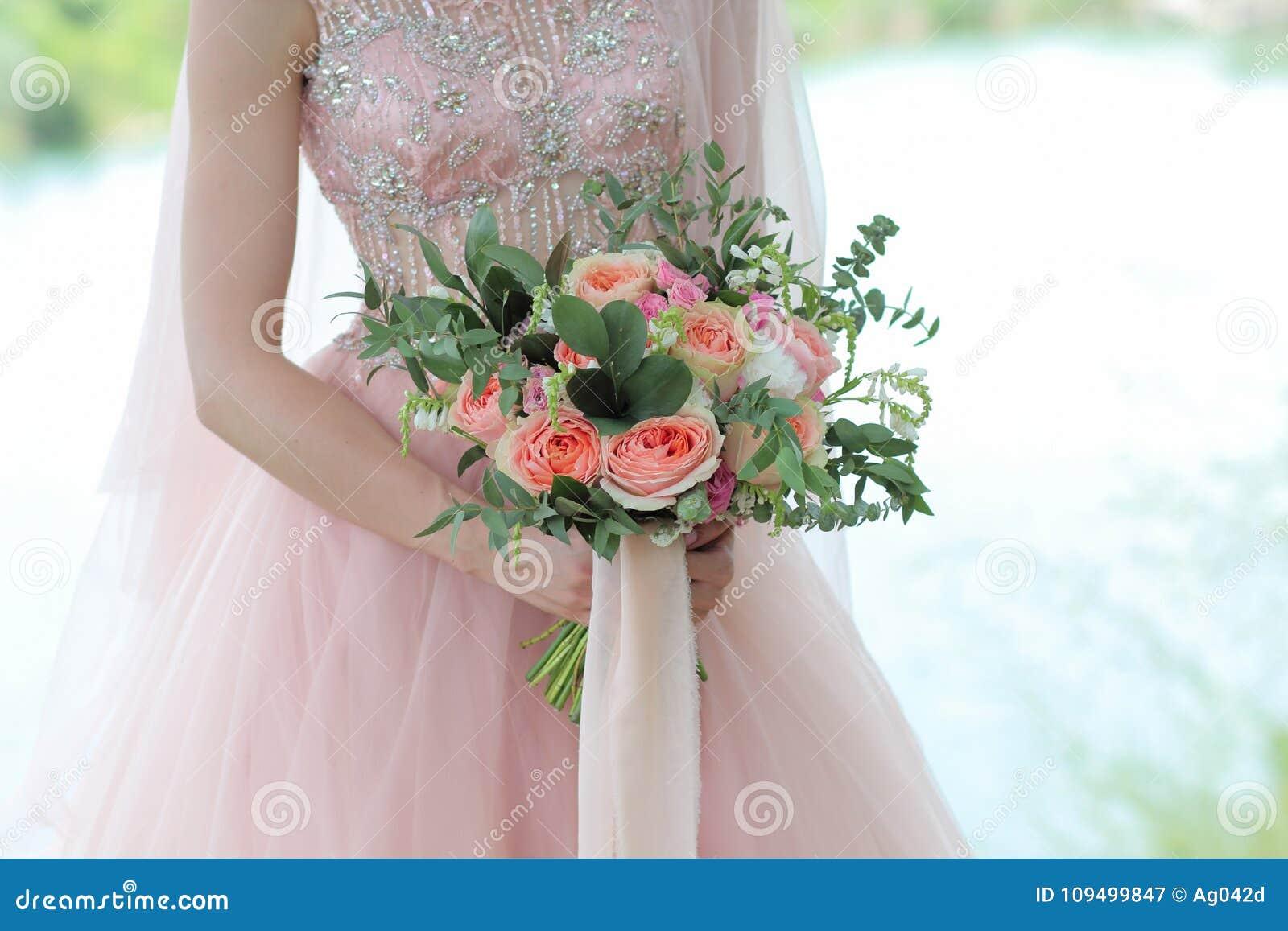 Bride Holding A Beautiful Bridal Bouquet. Wedding Bouquet Of Peach ...