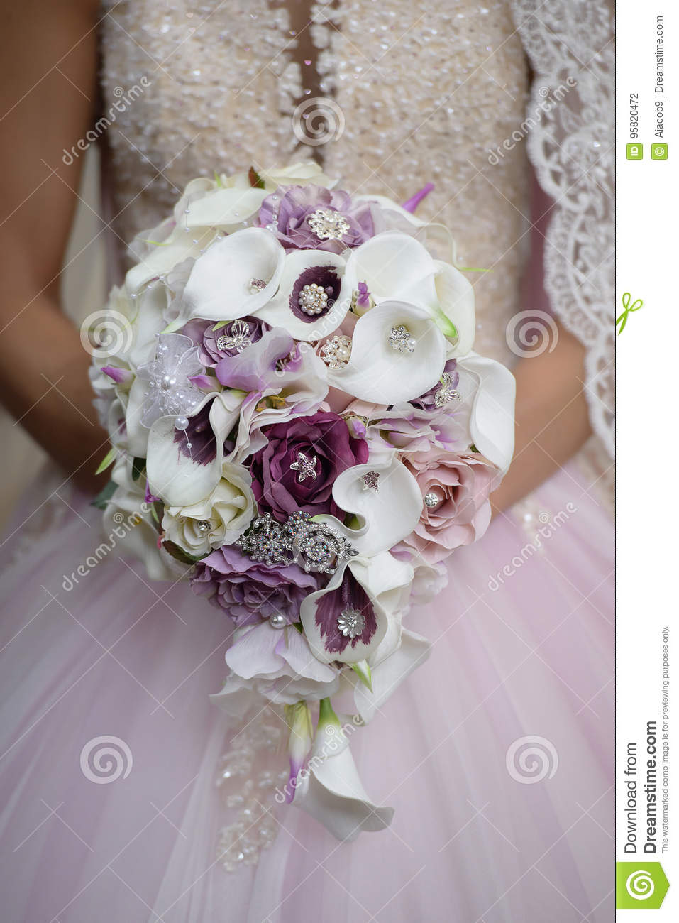 Bride Holding Wedding Bouquet Featuring Calla Lilies With Purple