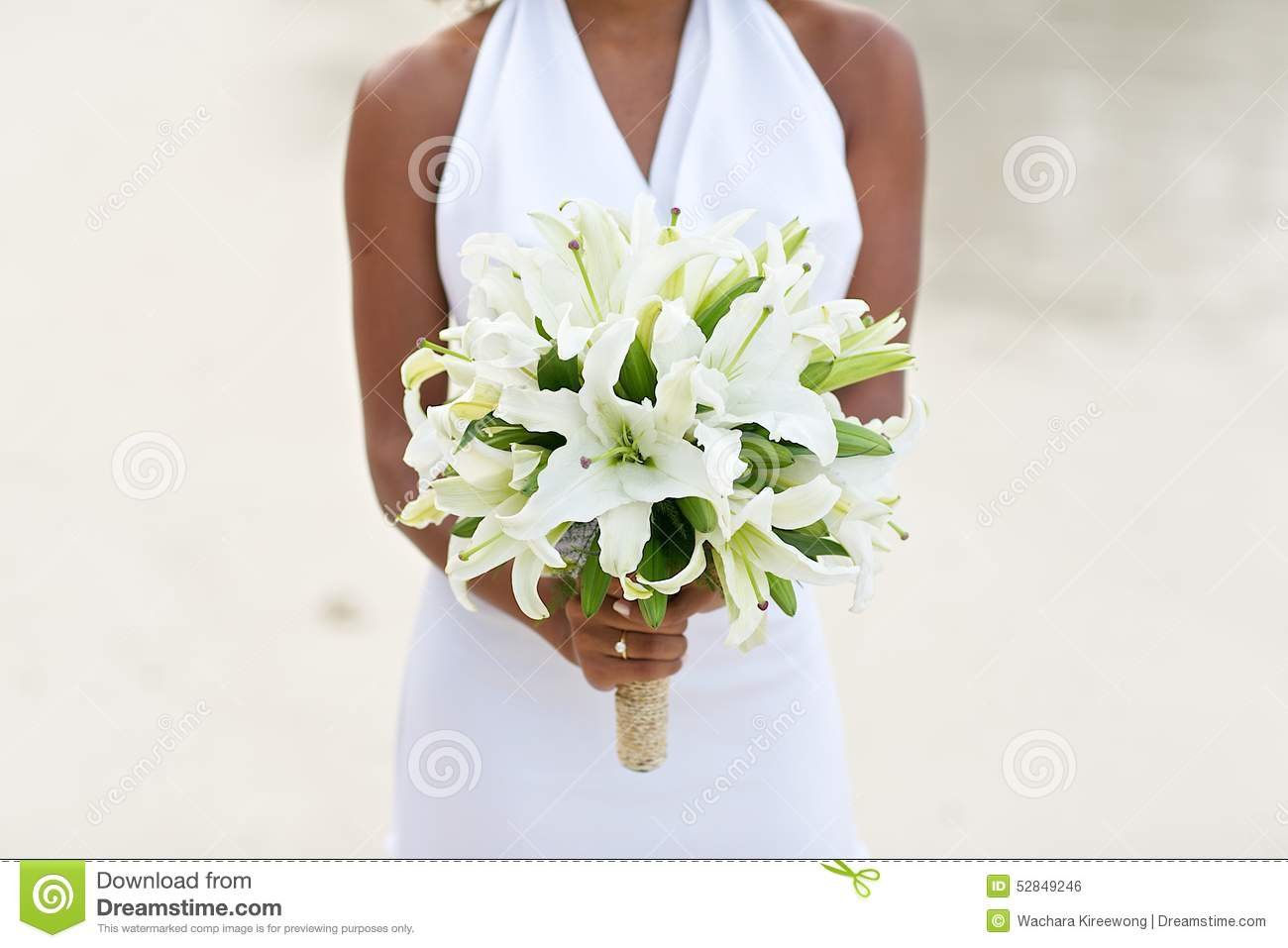 Bride holding white lily flower wedding bouquet stock photo beach bouquet bride flower holding lily sand wedding dhlflorist Choice Image