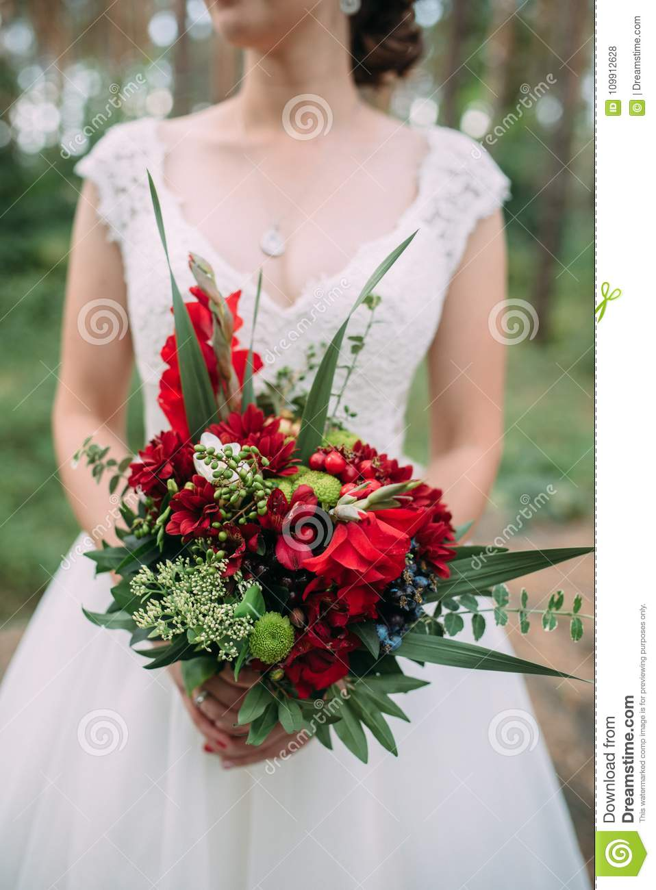 Bride Holds Wedding Bouquet With Red Flowers Stock Photo Image Of