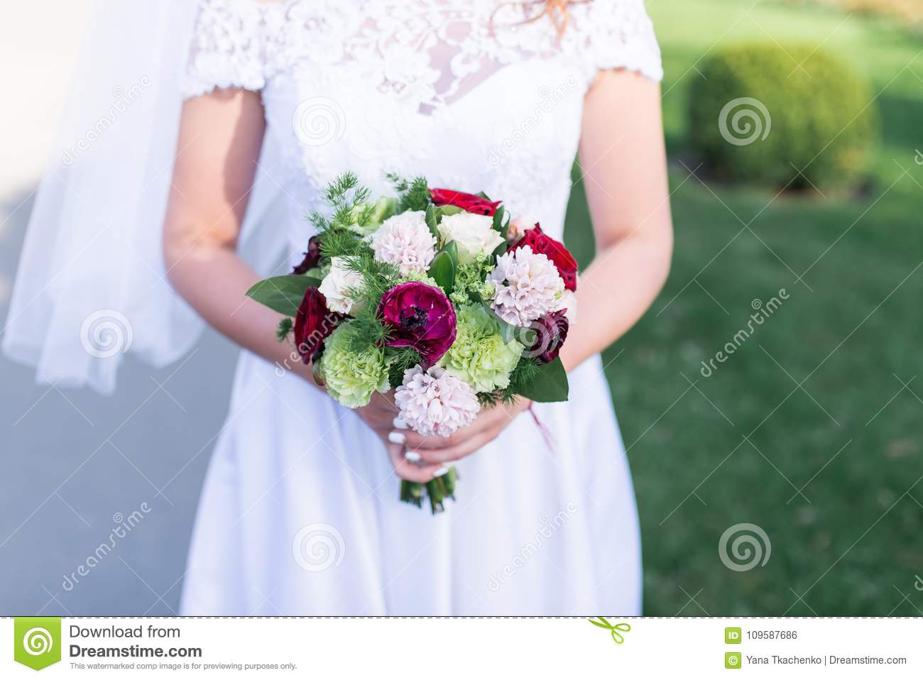 The Bride Holds A Wedding Bouquet With White Pink Red Flowers And Greenery Stock Photo Image Of Elegance Bouquet 109587686