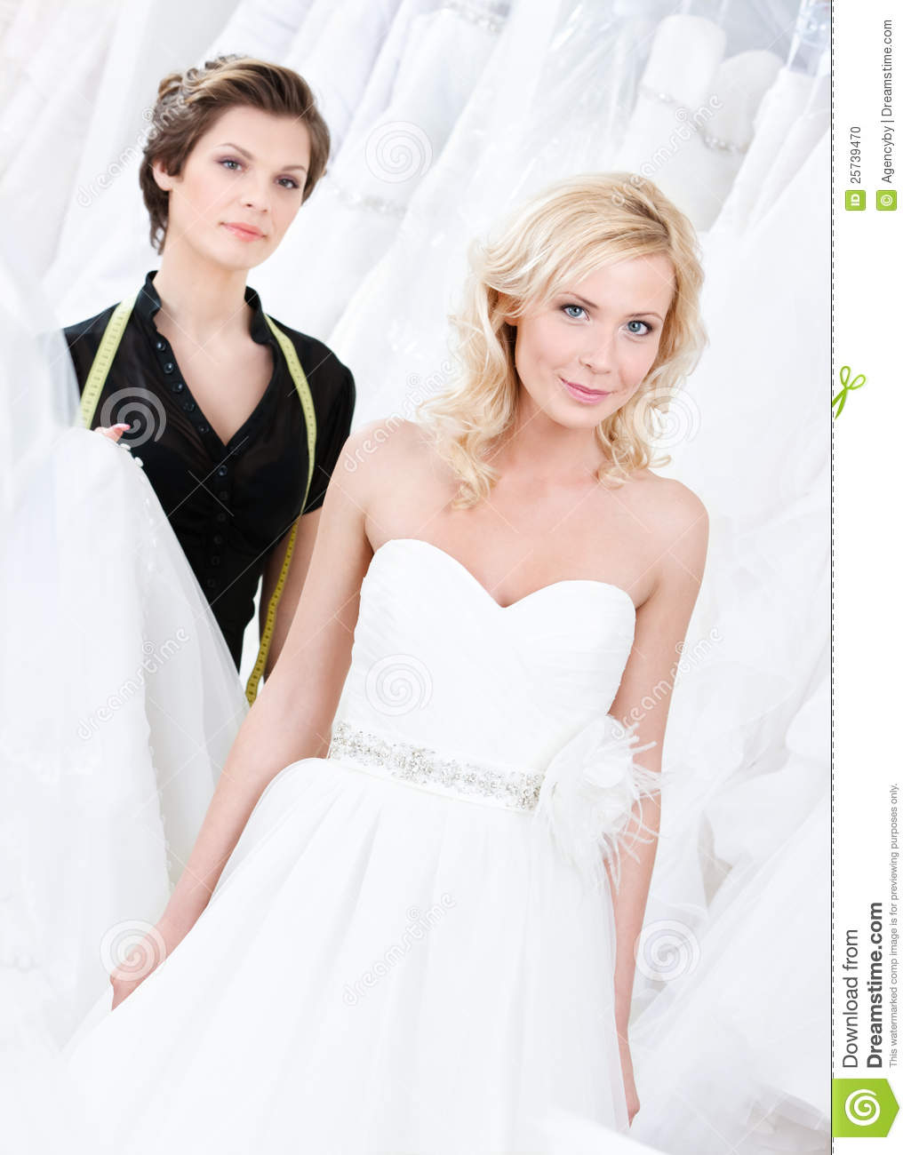 Bride likes her wedding gown