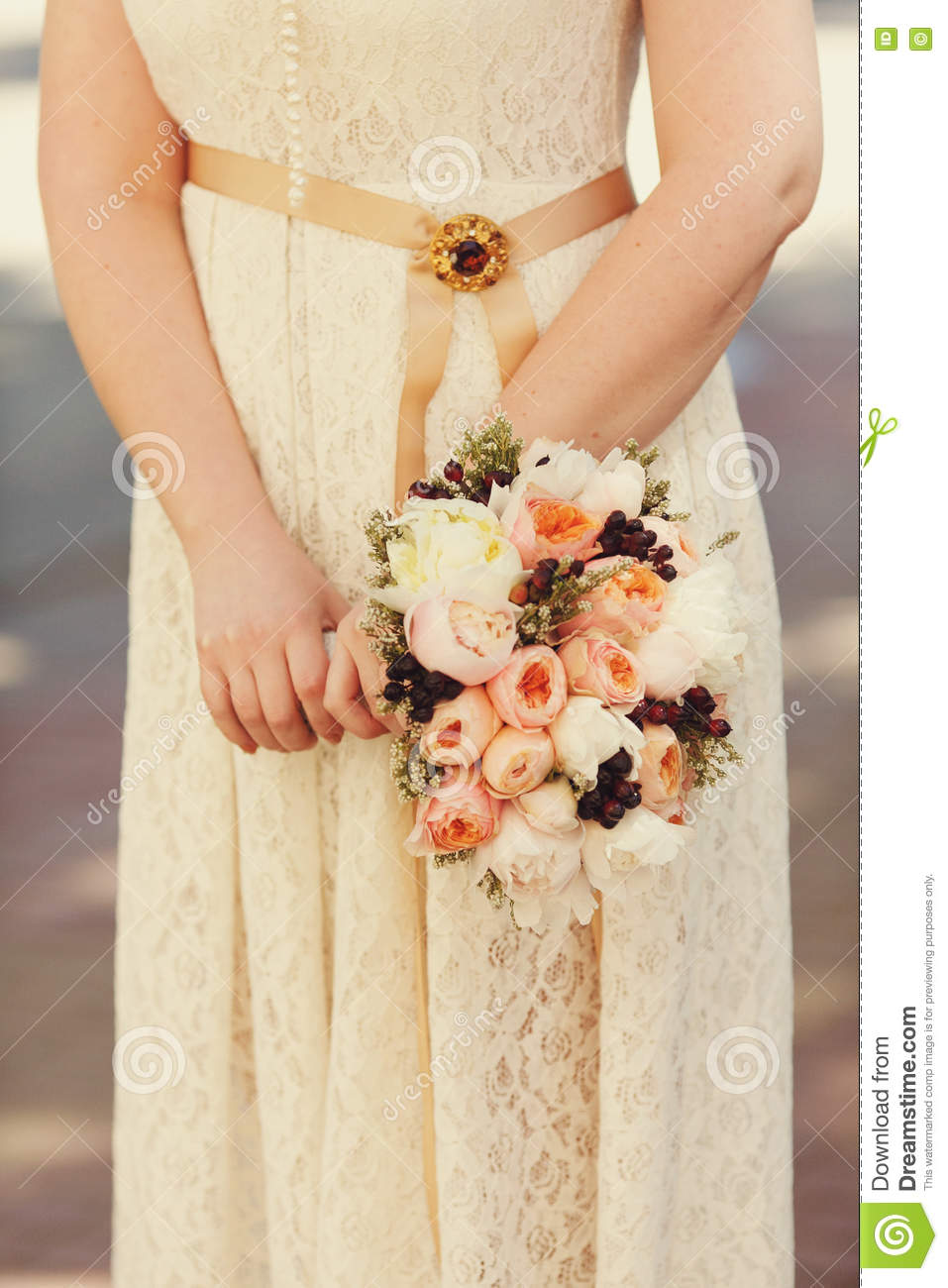 Bride In Peach Dress Holds A Wedding Bouquet Of Pink Flowers Stock