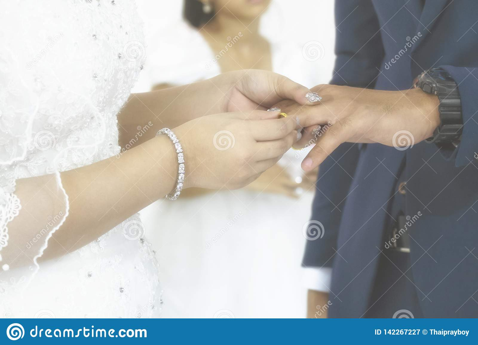 Bride Put the Wedding Ring to Her Groom in the Wedding Ceremony. Vintgae Style Picture with Gain Added