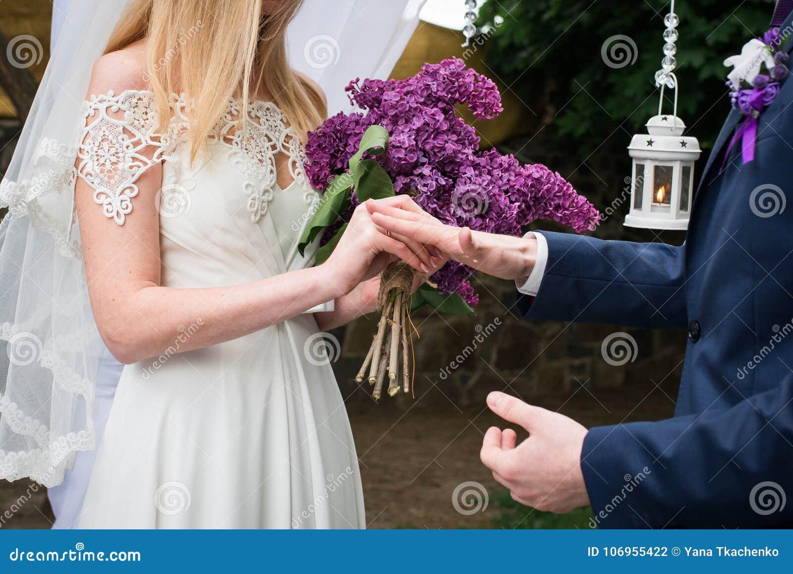 Bride Puts Wedding Ring On Grooms Finger. Bride And Groom Exchange Rings In Wedding Day. Wedding