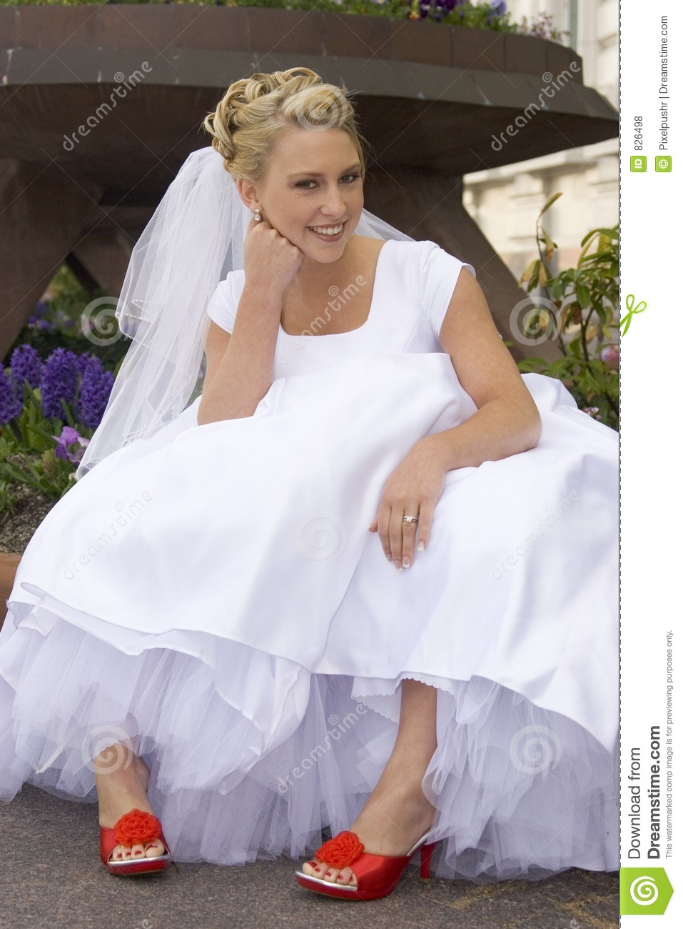 Bride with Red Shoes Sitting on Curb
