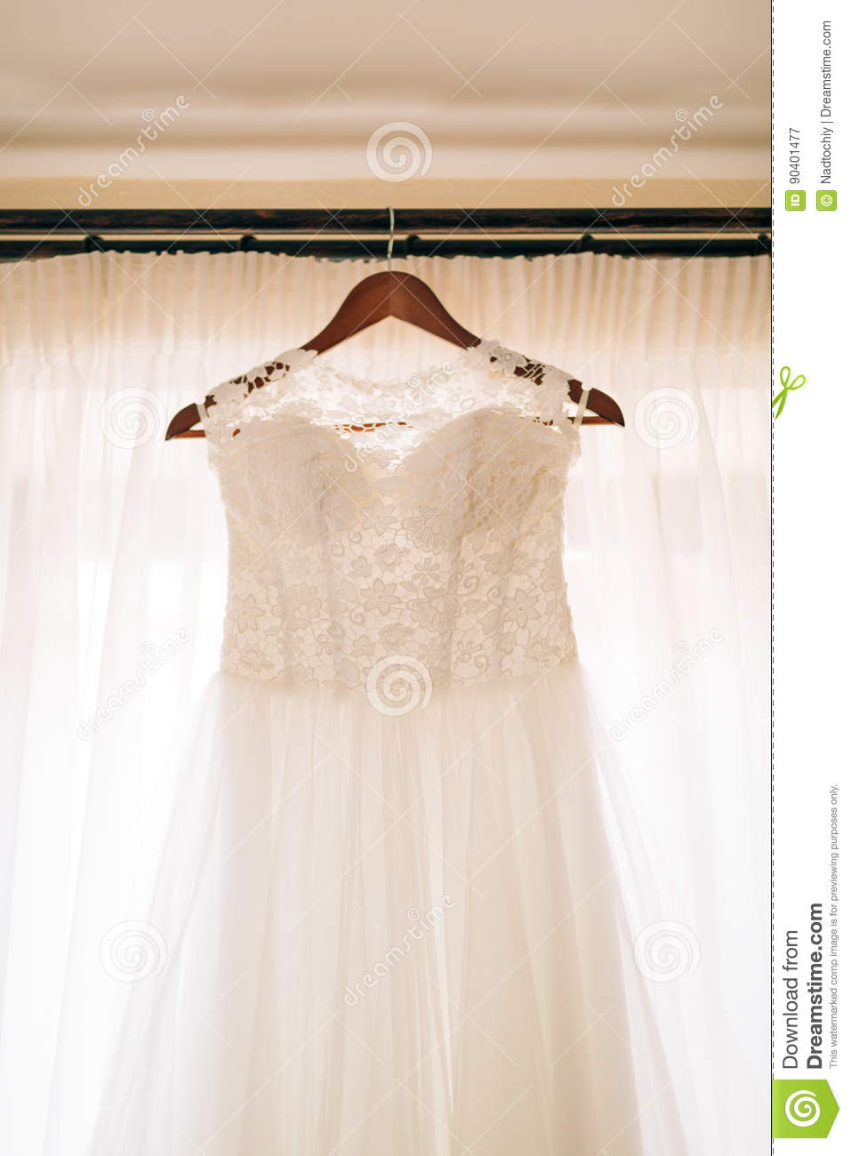 70c5237e3ee The Bride`s Dress Hangs On The Cornice Stock Image - Image of lace ...