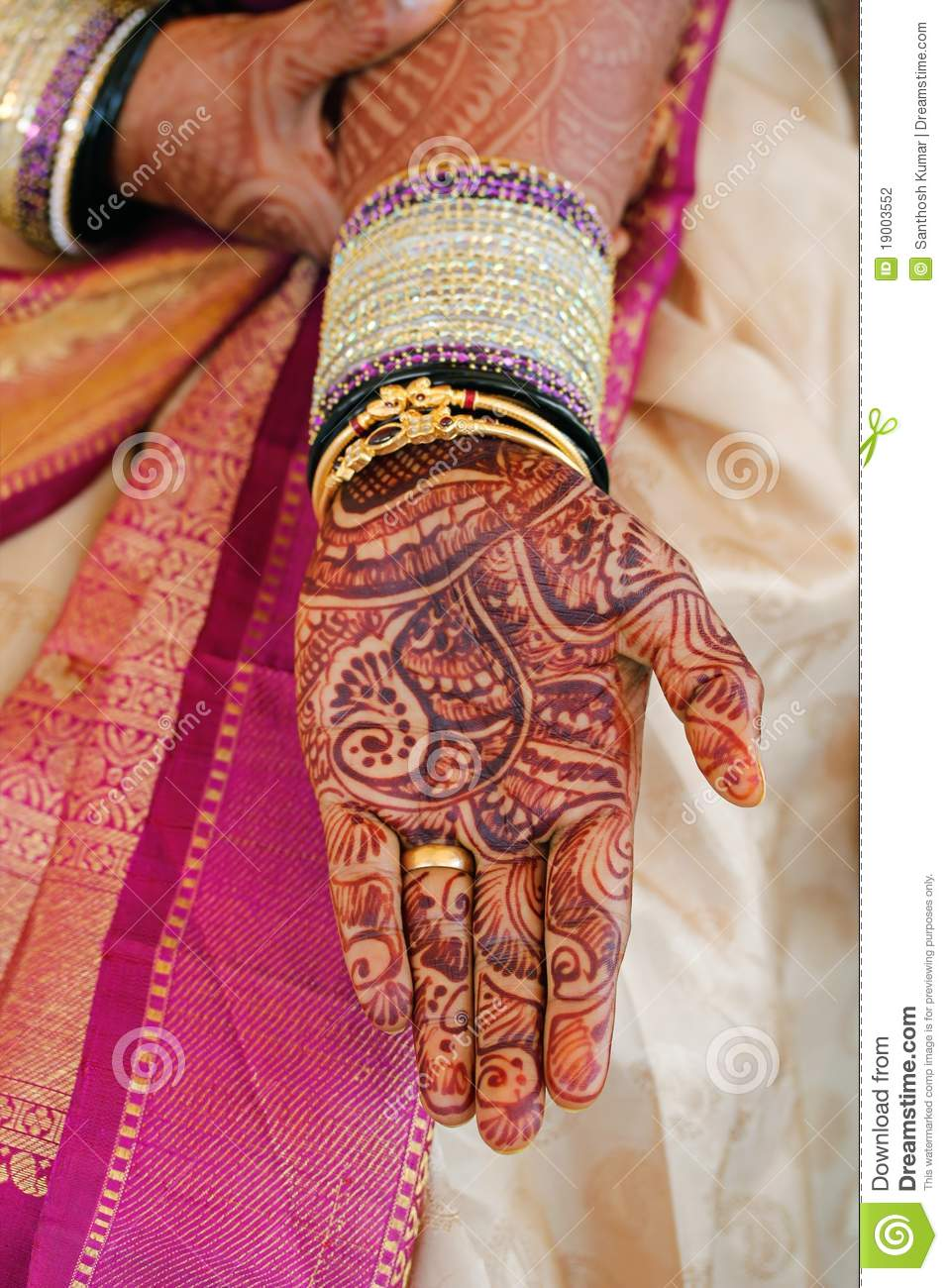Bride\'s Hand With Henna And Bangles Stock Photo - Image: 19003552