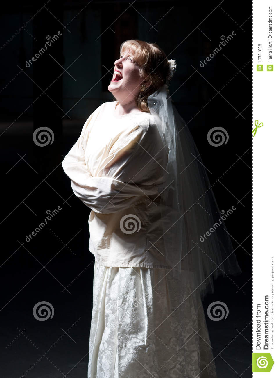 bride screaming in straight jacket royalty free stock
