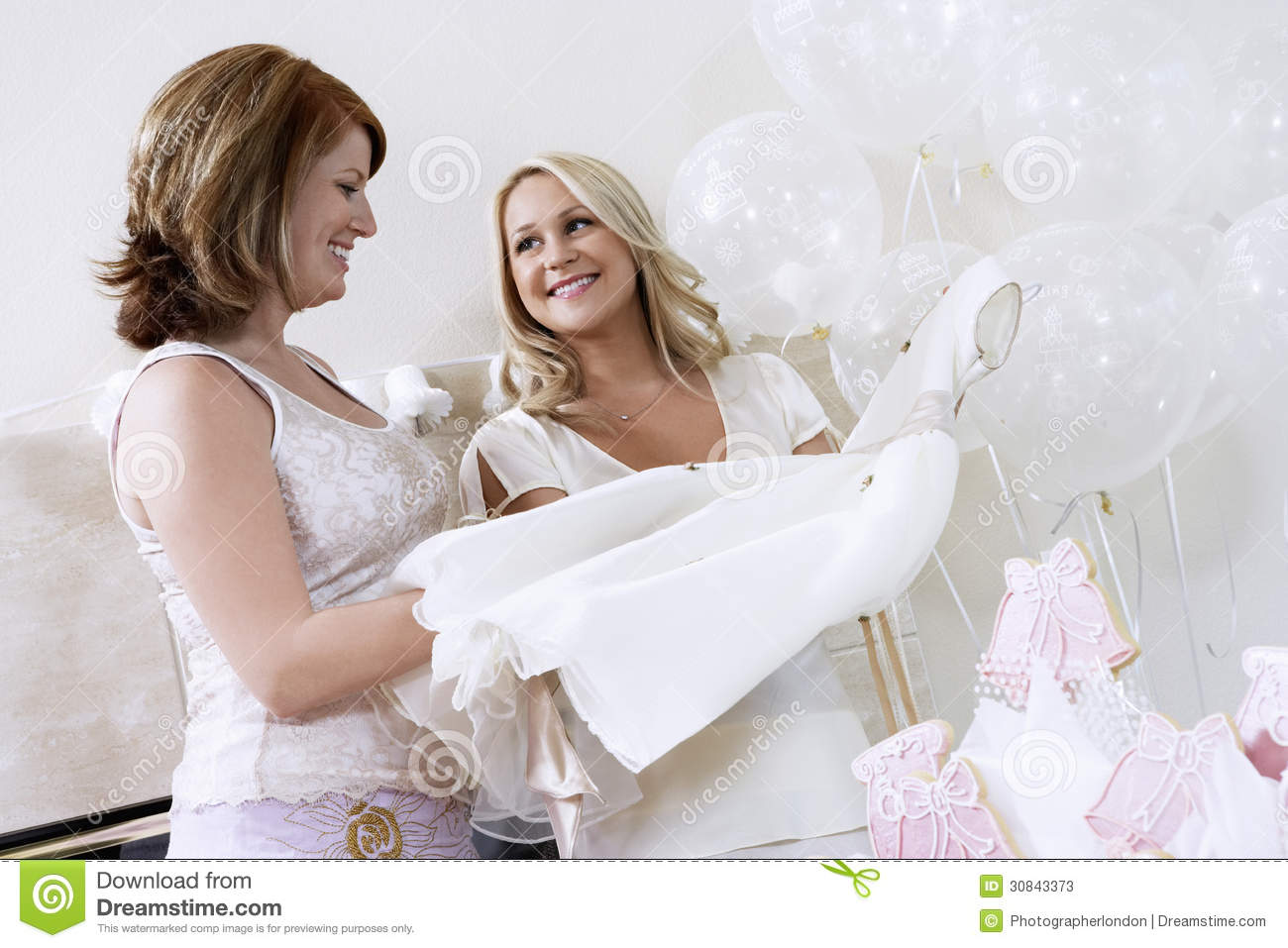 bride showing off dress at bridal shower