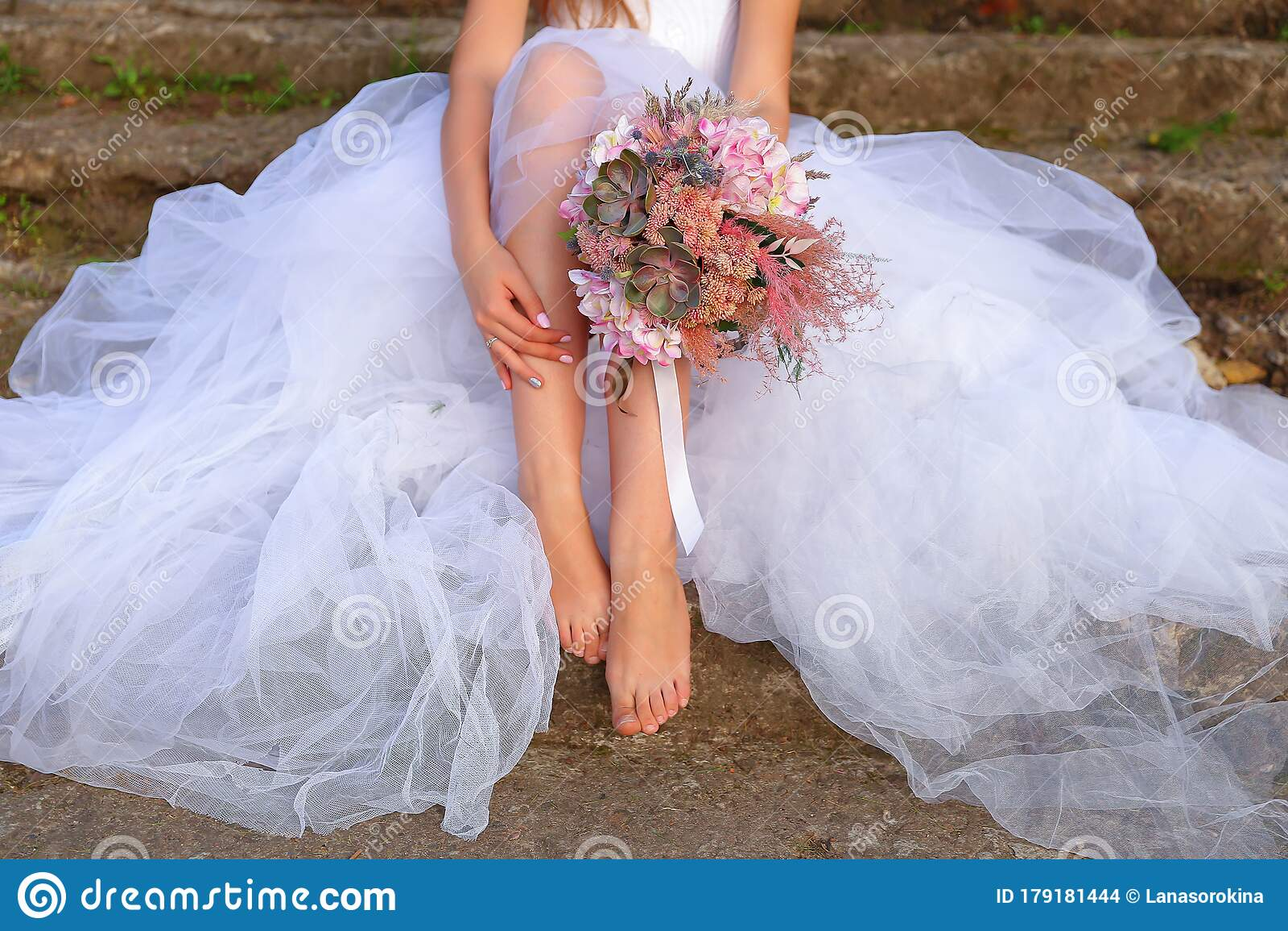 Bride Sitting On The Stone Steps And Holding Wedding Bouquet Stock Photo Image Of Beautiful Harmonious 179181444