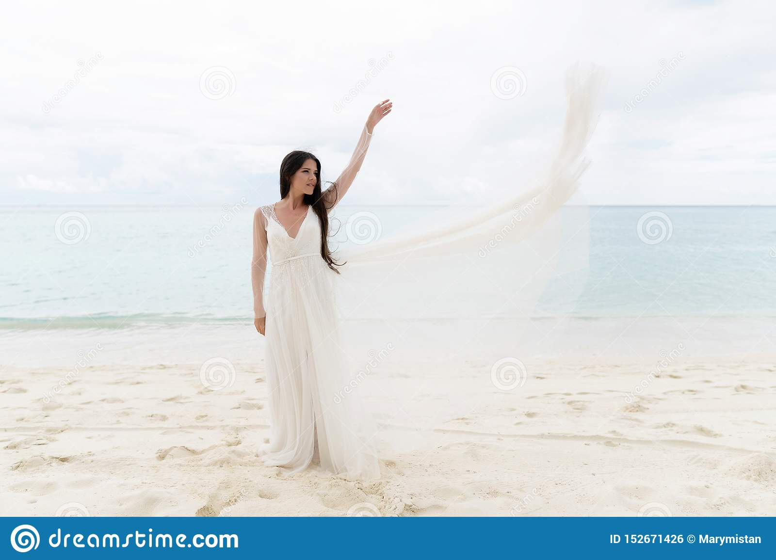 The bride throws a white dress in the air