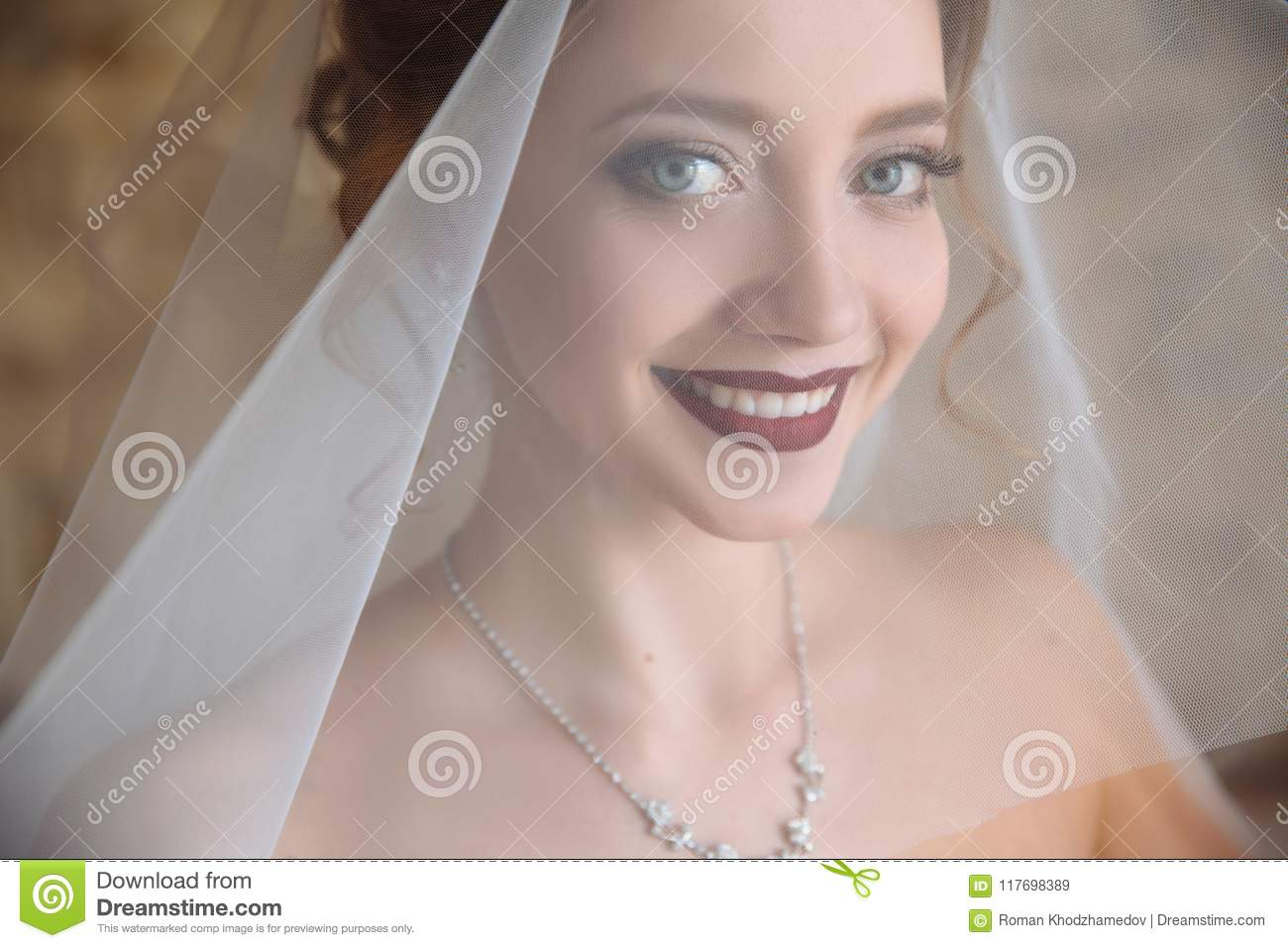 The Bride Tries On The Veil And Smiles A Beautiful Girl In A