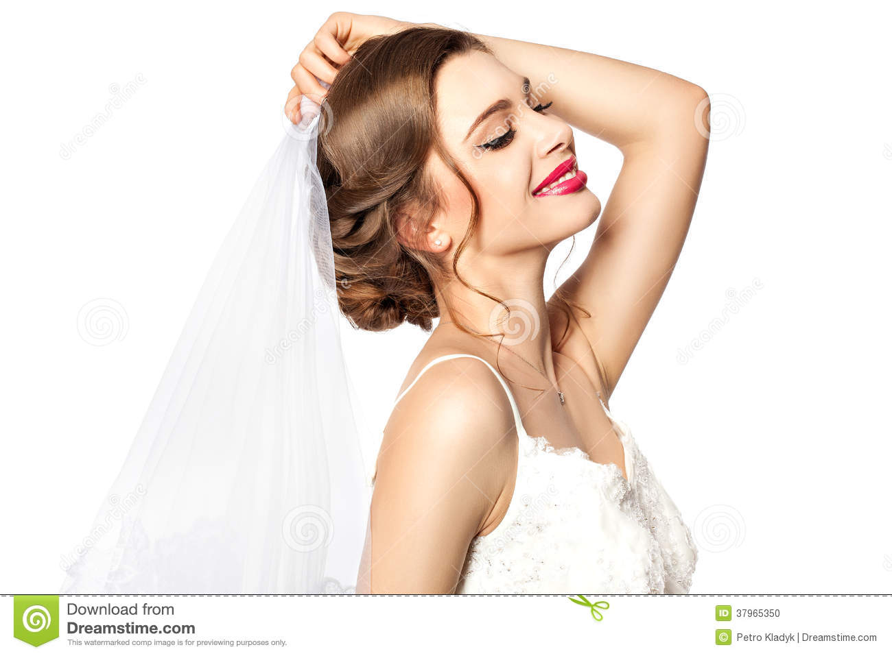 Bride trying on veils.