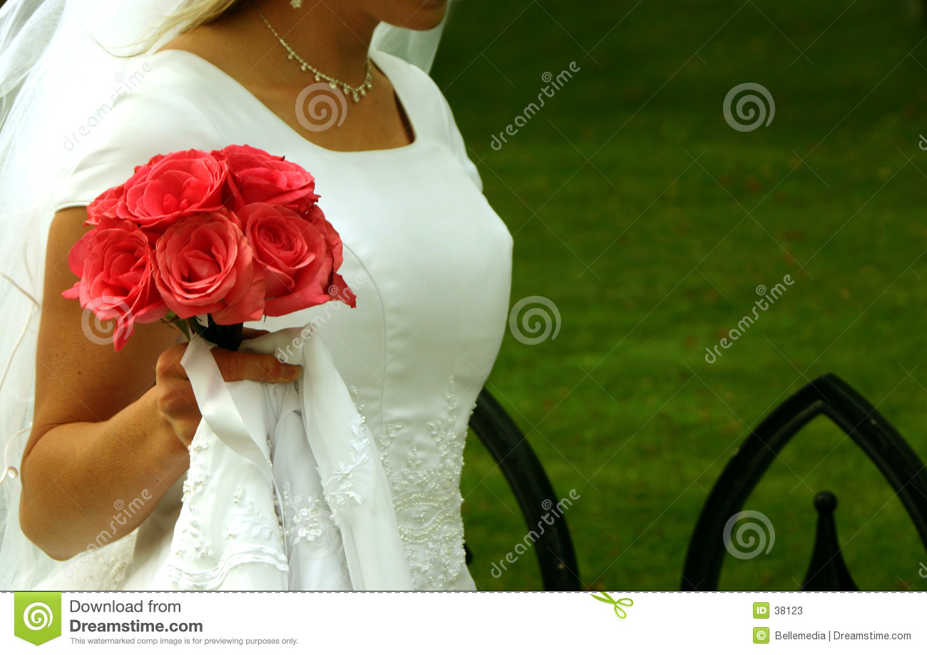 Bride walking with her flowers