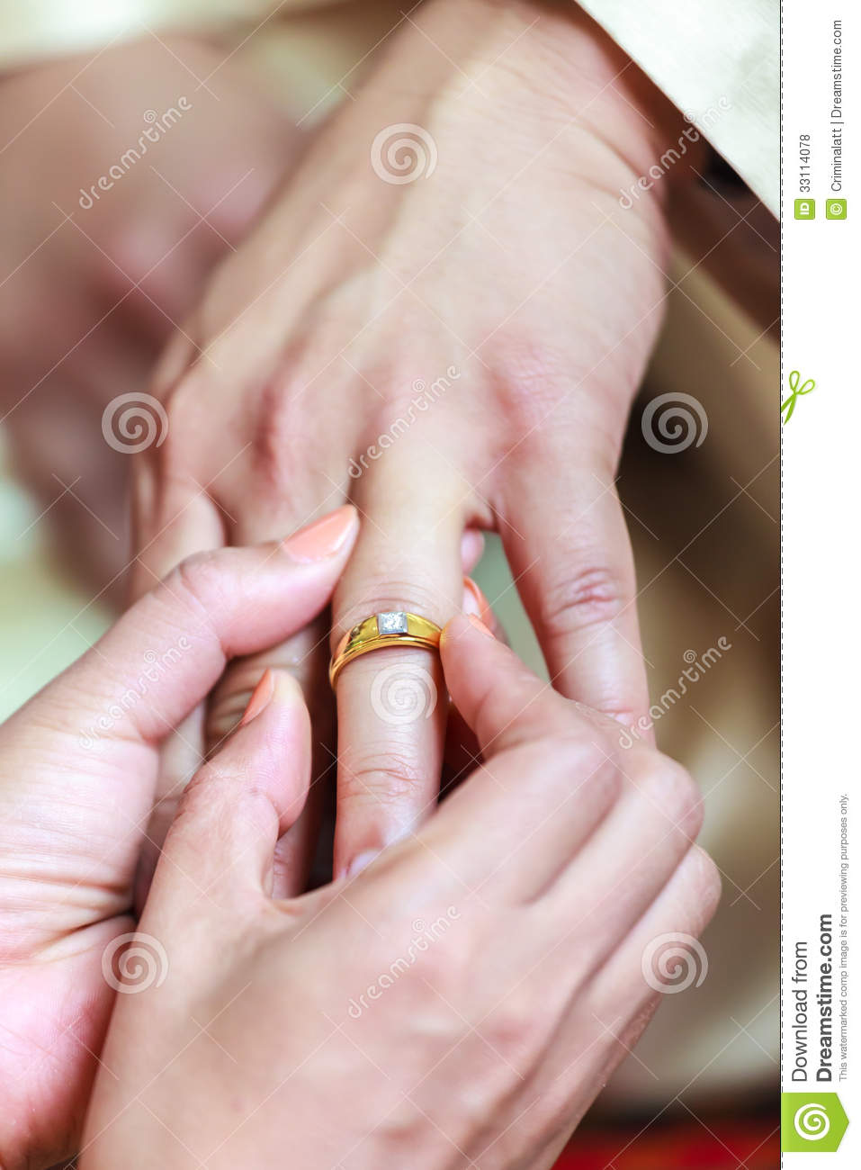 Bride Wearing Ring On Groom\'s Finger Stock Photo - Image of people ...