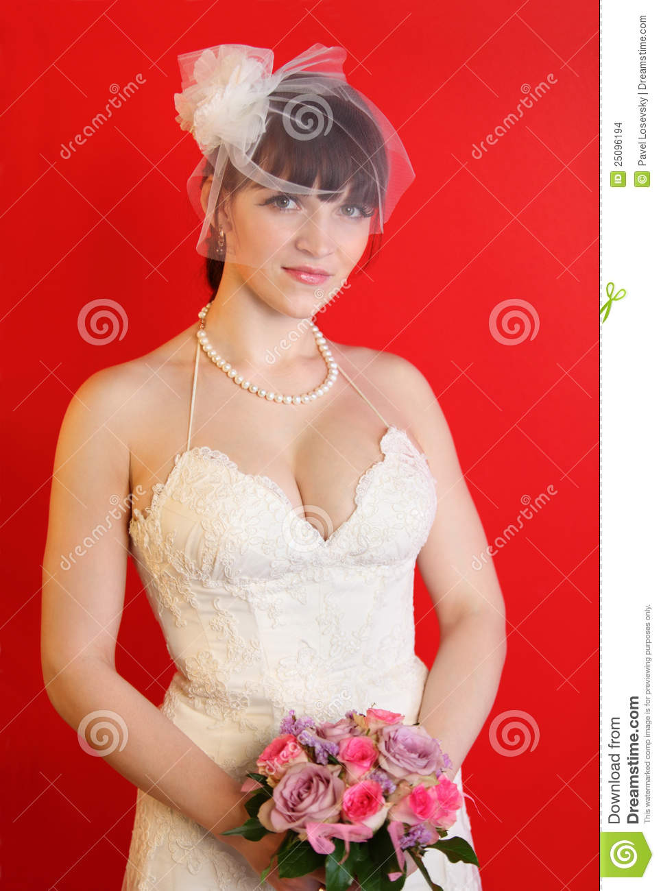 Bride wearing white dress holds bouquet of roses