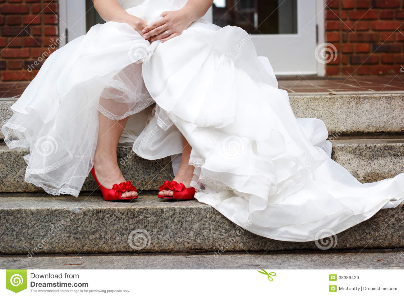 Red Shoes For Wedding | Bride Wearing White Wedding Dress And Red Shoes Stock Photo Image