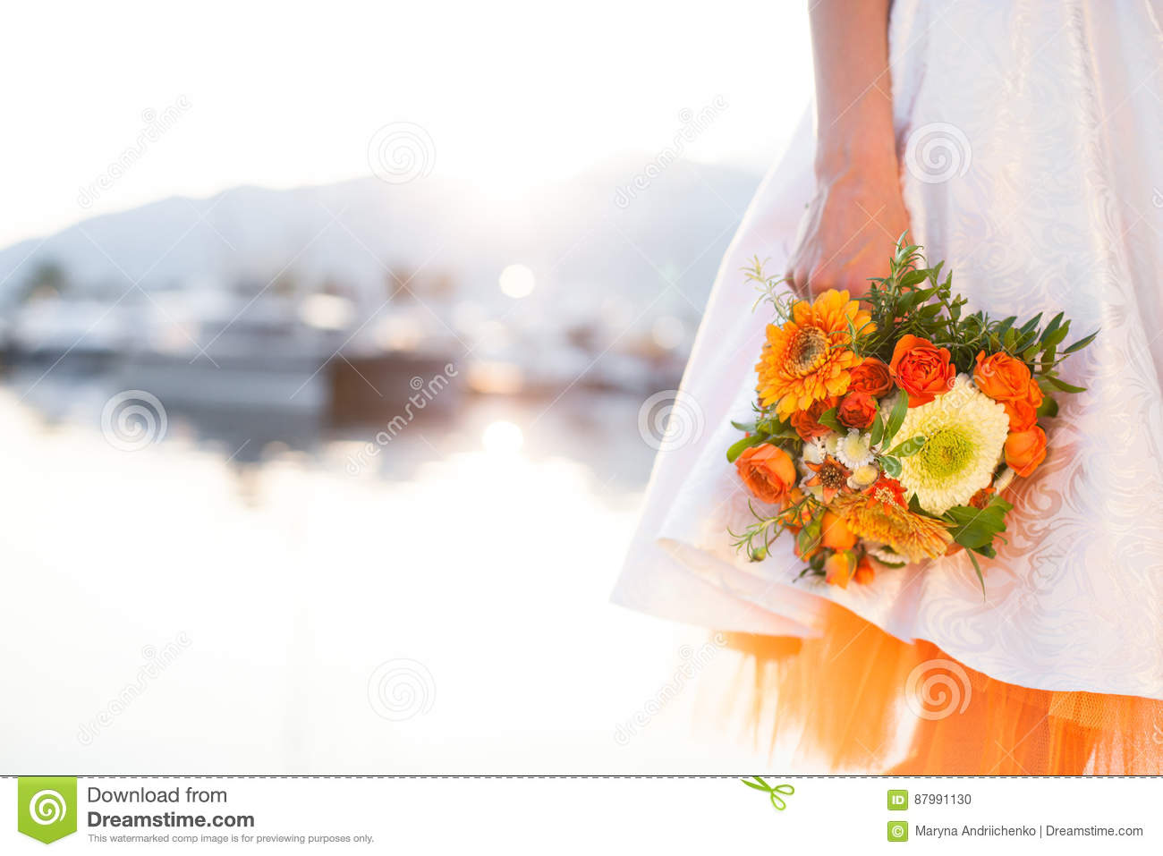 The Bride With Wedding Bouquet From Orange Flowers Pomegranate