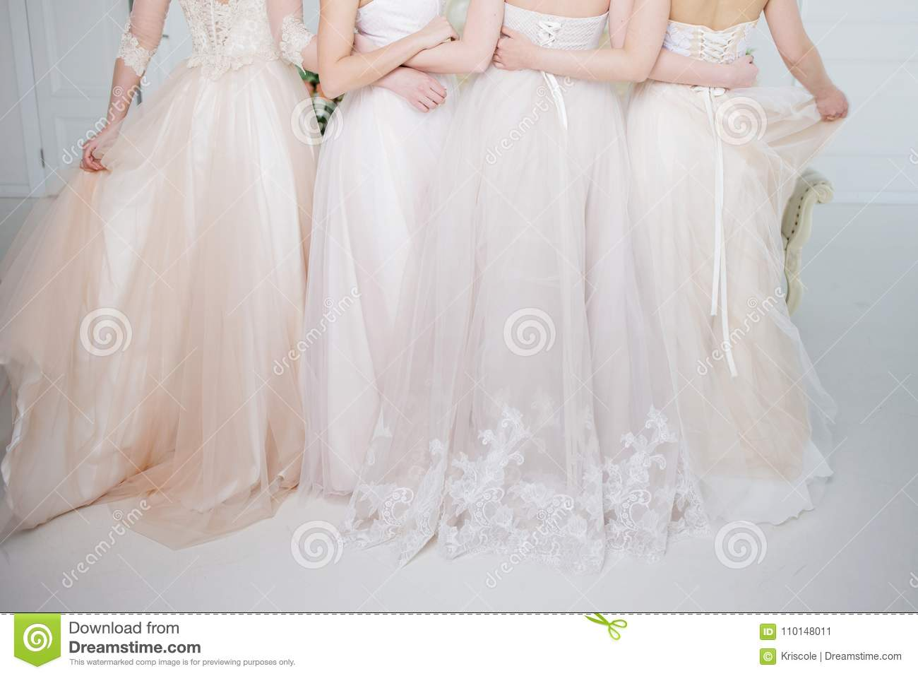 38c9d9c355 Bride In Wedding Salon. Four Beautiful Girl Are In Each Other`s Arms ...