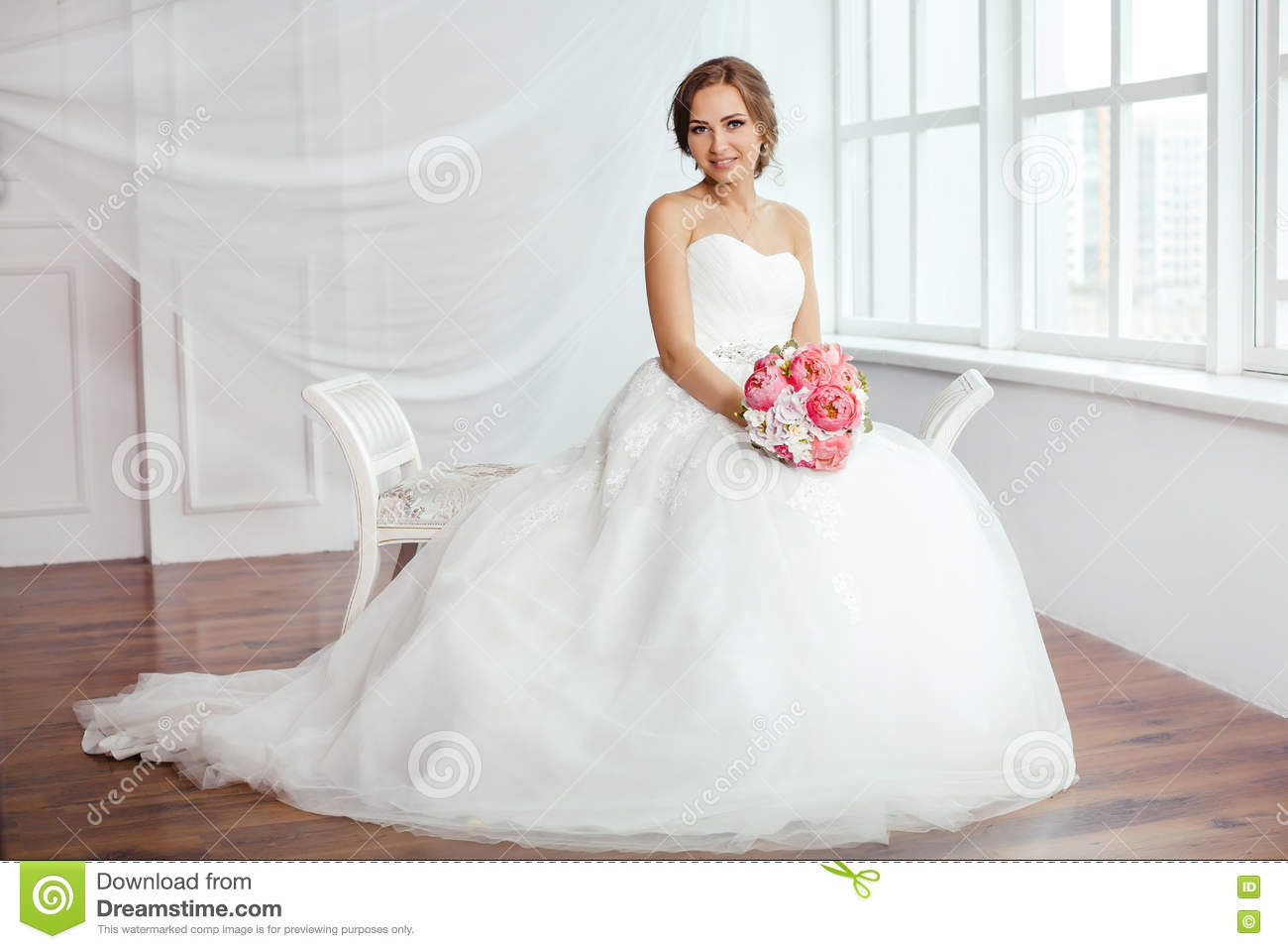The Bride. Young Women With Wedding Dress In Very Bright Room, Stock ...