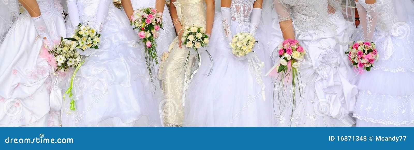 Brides hold bouquets