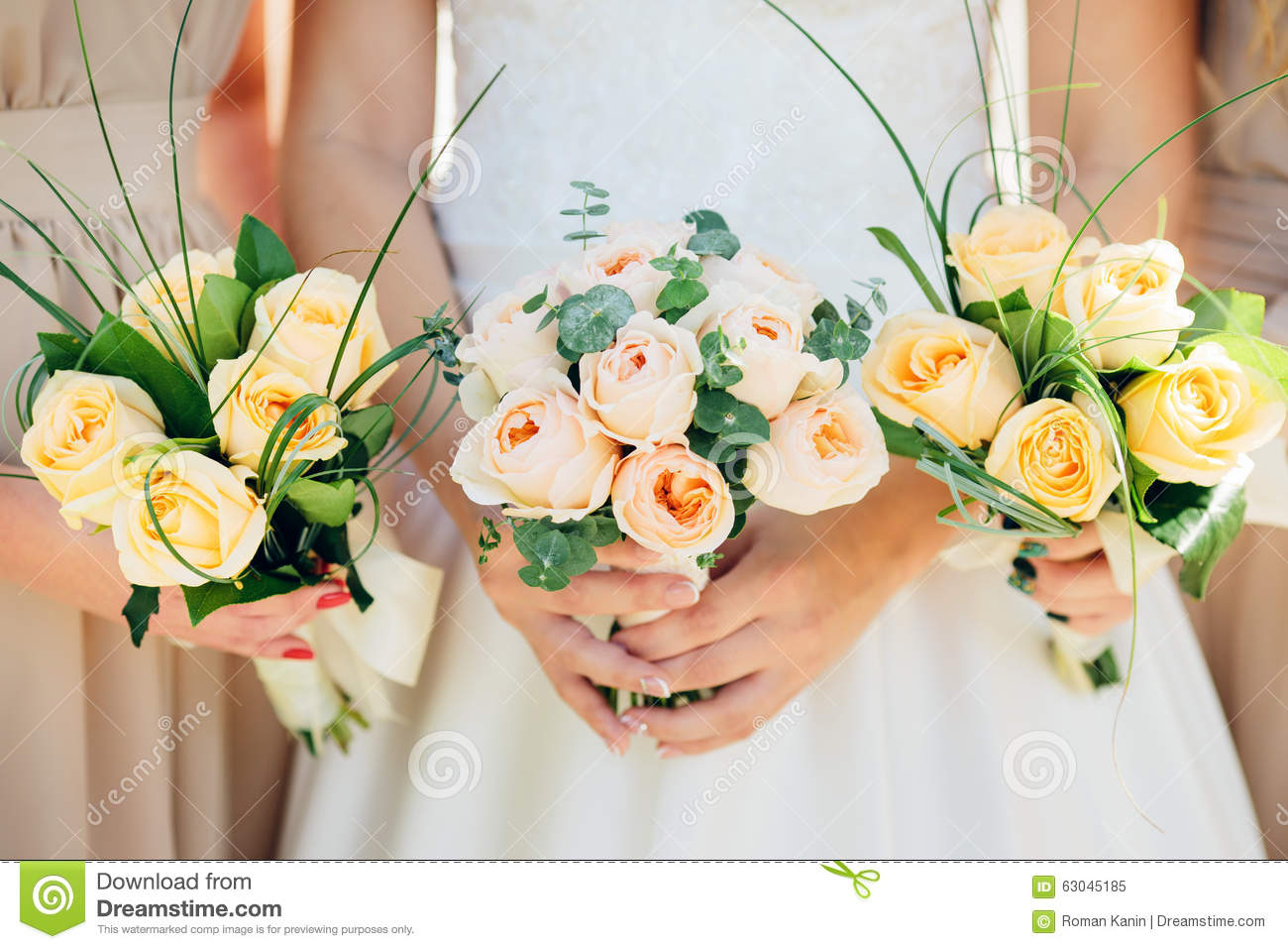 Bridesmaid Dresses Are Holding Bouquets In A Rustic Style Stock