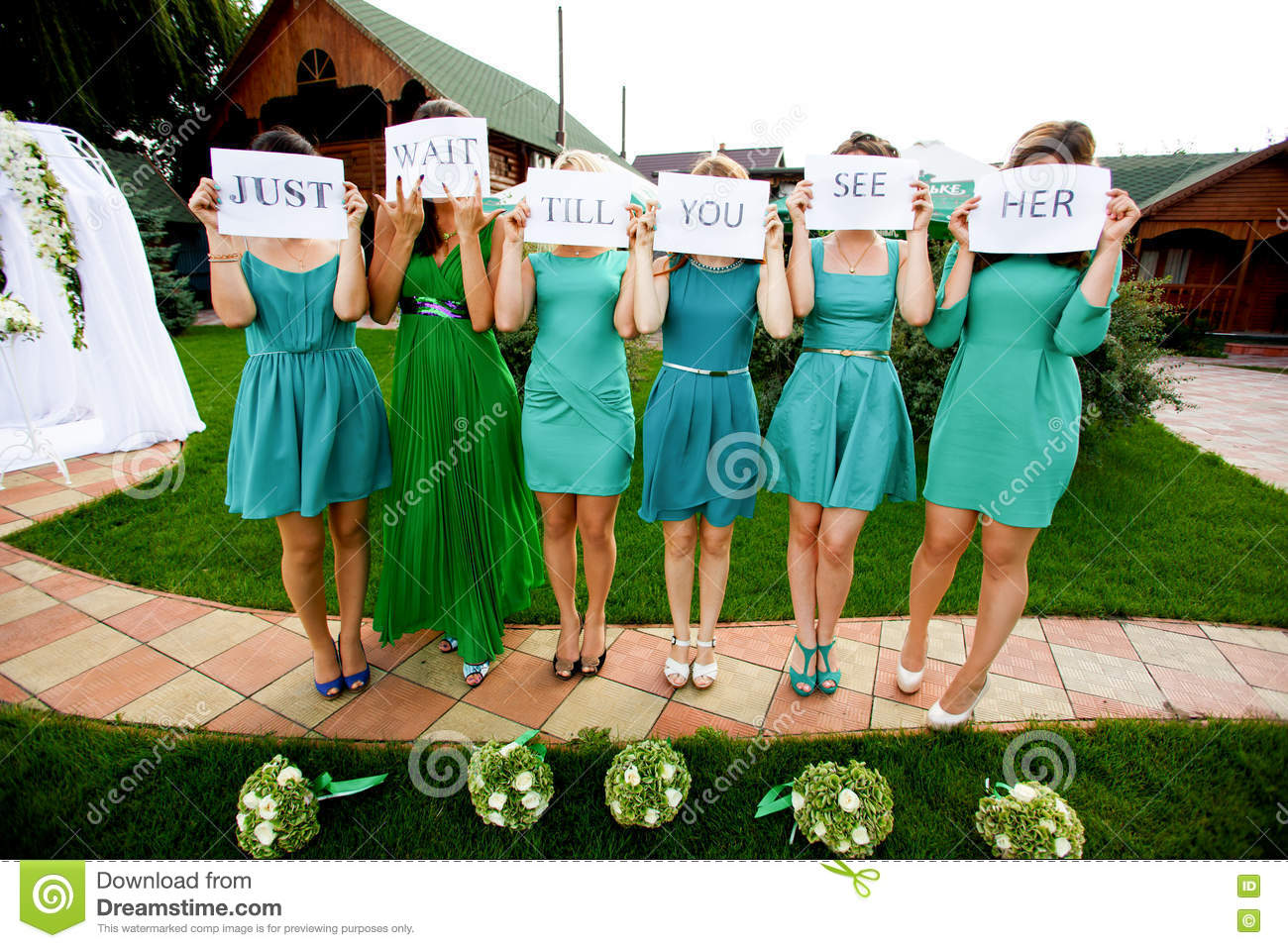 Bridesmaids hold a lettering  Just wait till you see her  printe