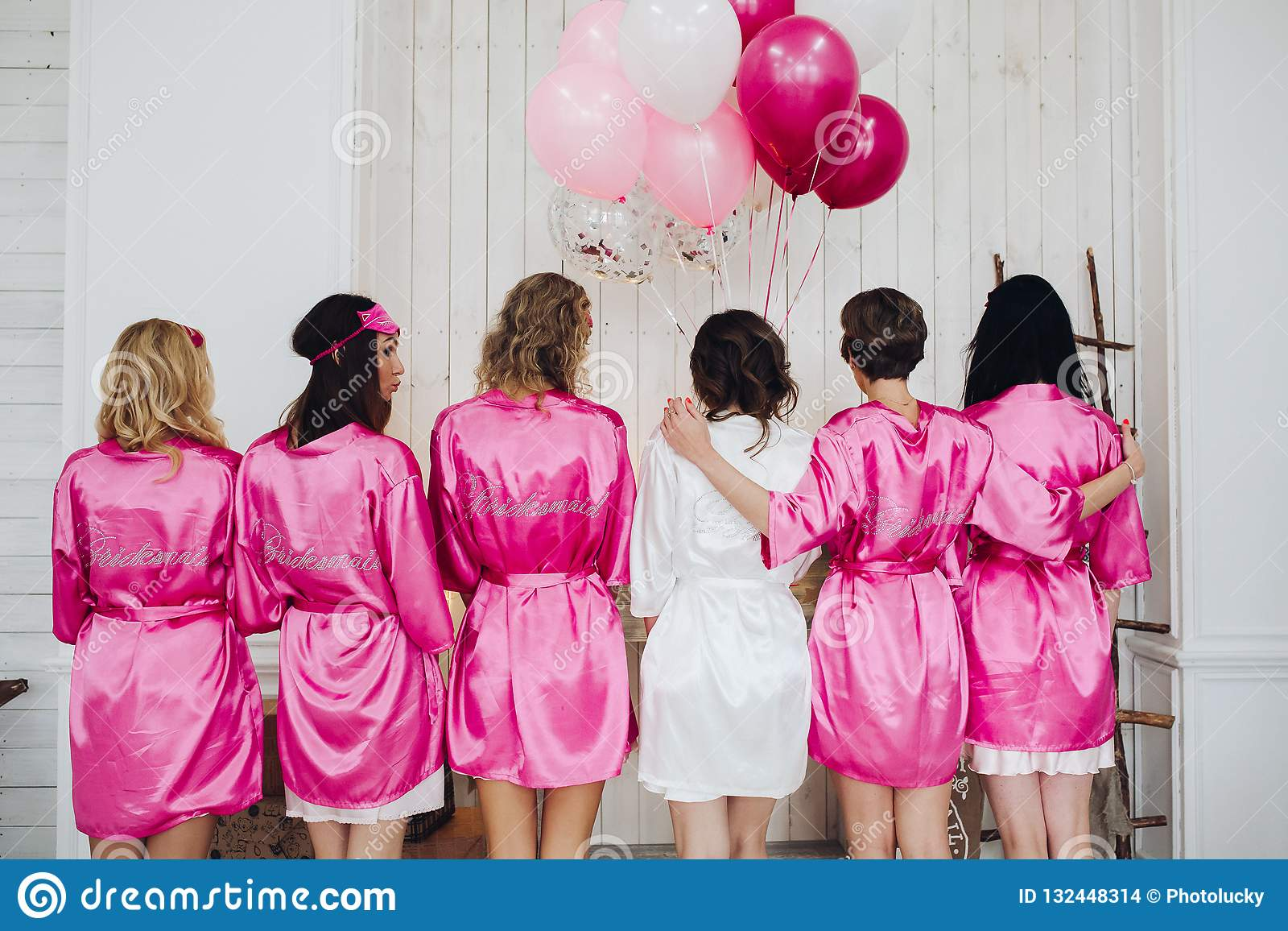 Bridesmaids In Pink Silk Robes With The Word Bridesmaid On Bac Stock Photo Image Of Caucasian Girlfriend 132448314