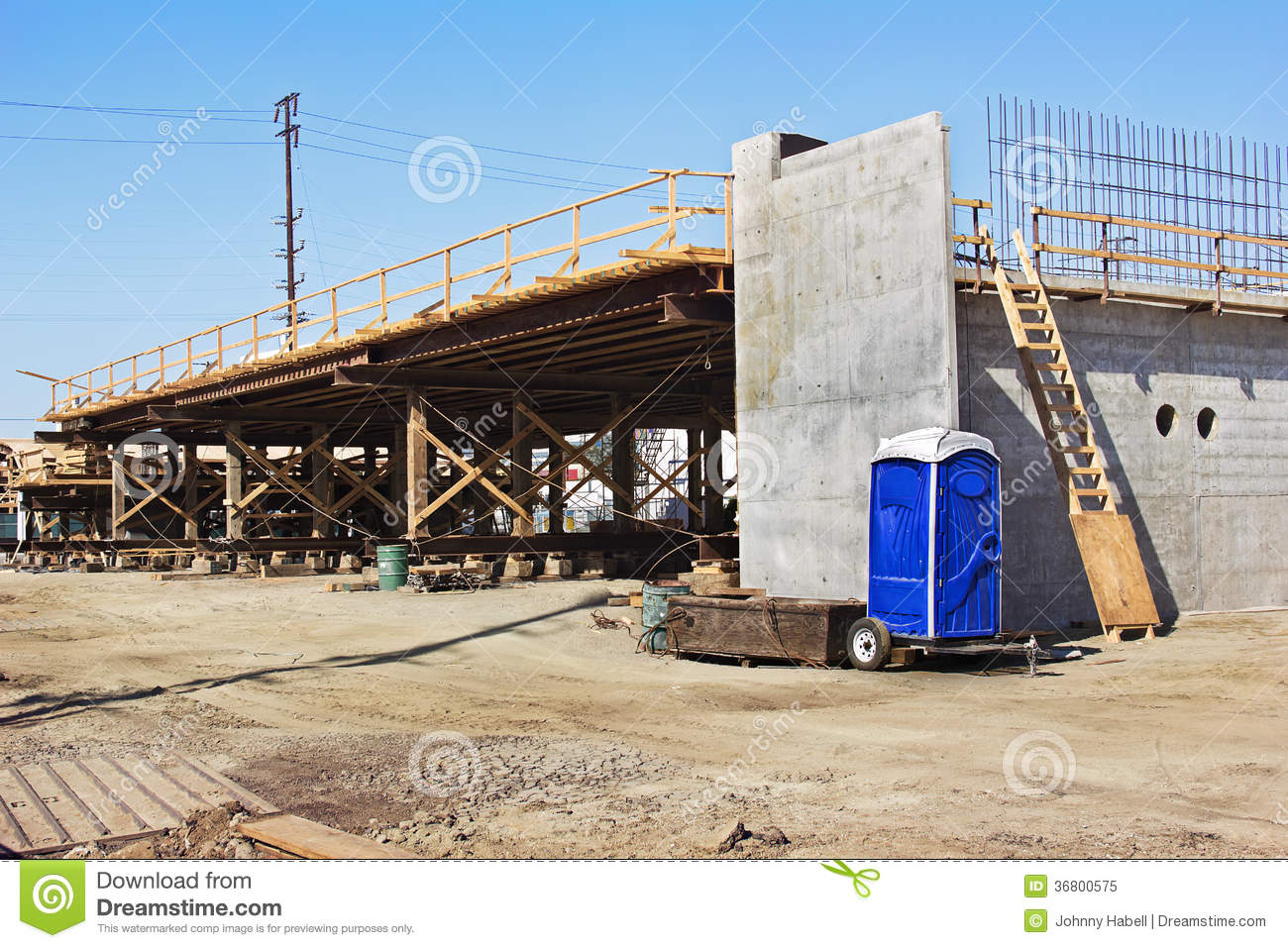 bridge construction with porta potty royalty free stock