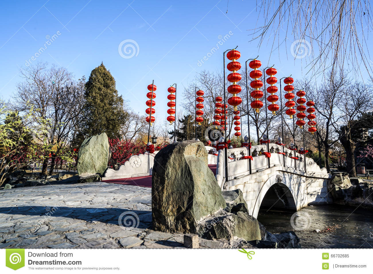 a bridge in a historic traditional garden of beijing china in