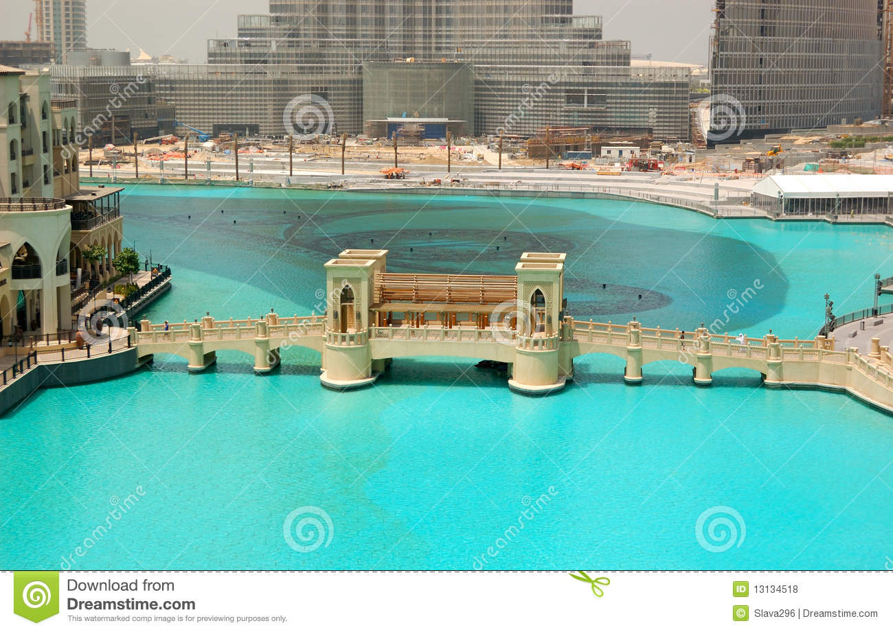 DUBAI  AUGUST 27: The bridge over manmade lake in Dubai downtown. It