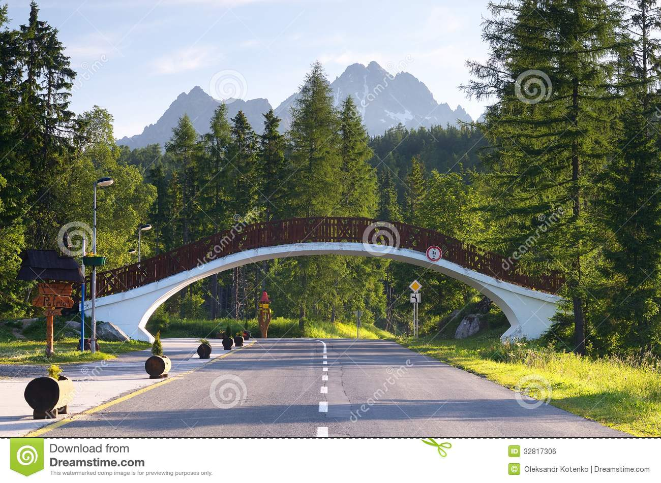 ... road in a mountain resort and a pedestrian bridge. Tatras, Slovakia