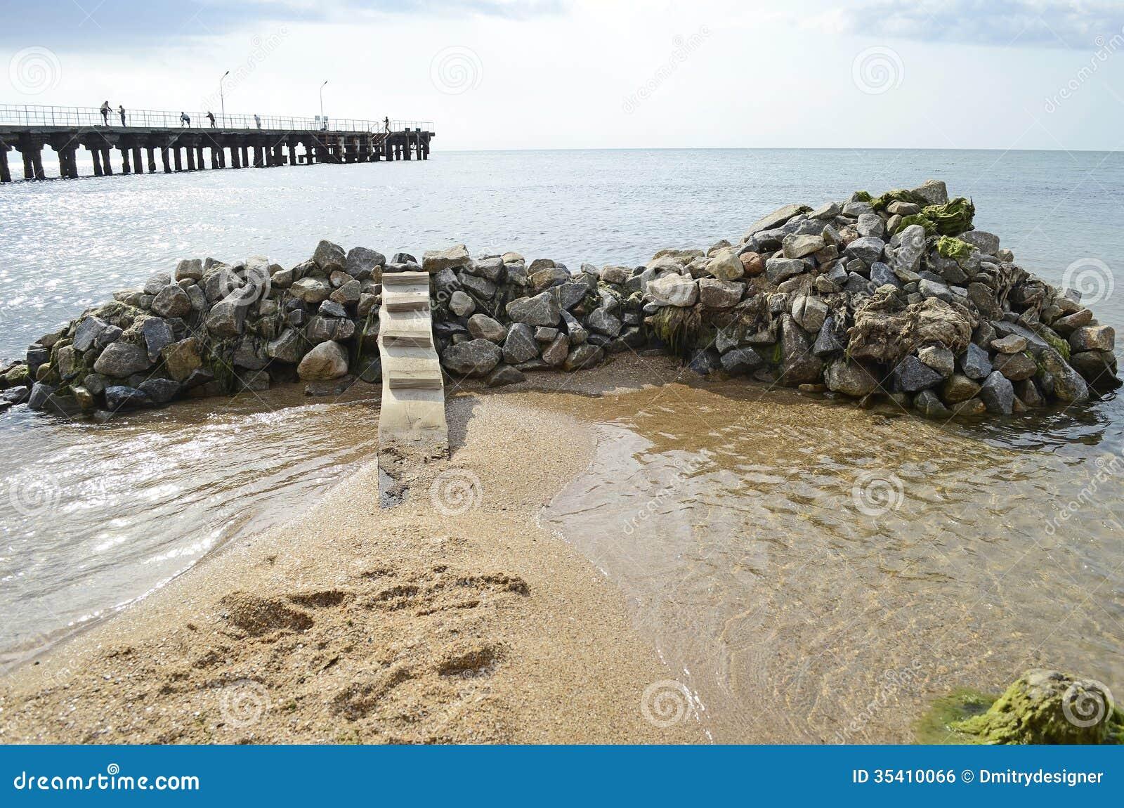 Landscape bridge on a pile of rocks in the sea crimea ukraine