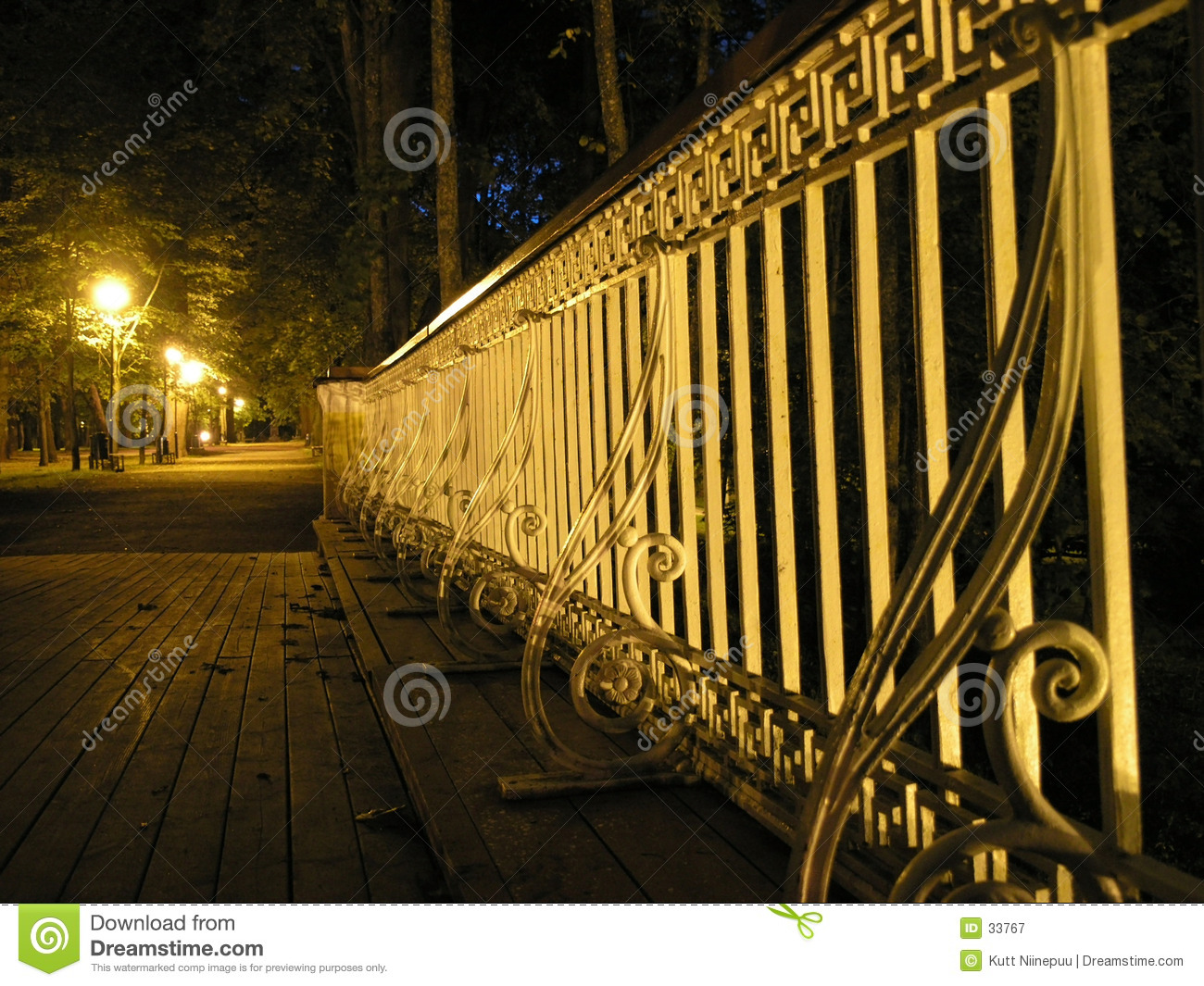 Bridge railing at night