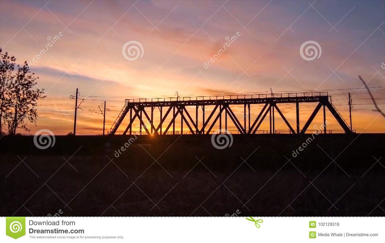 Bridge road. Train traffic transportation. Timelapse railway bridge on sunrise