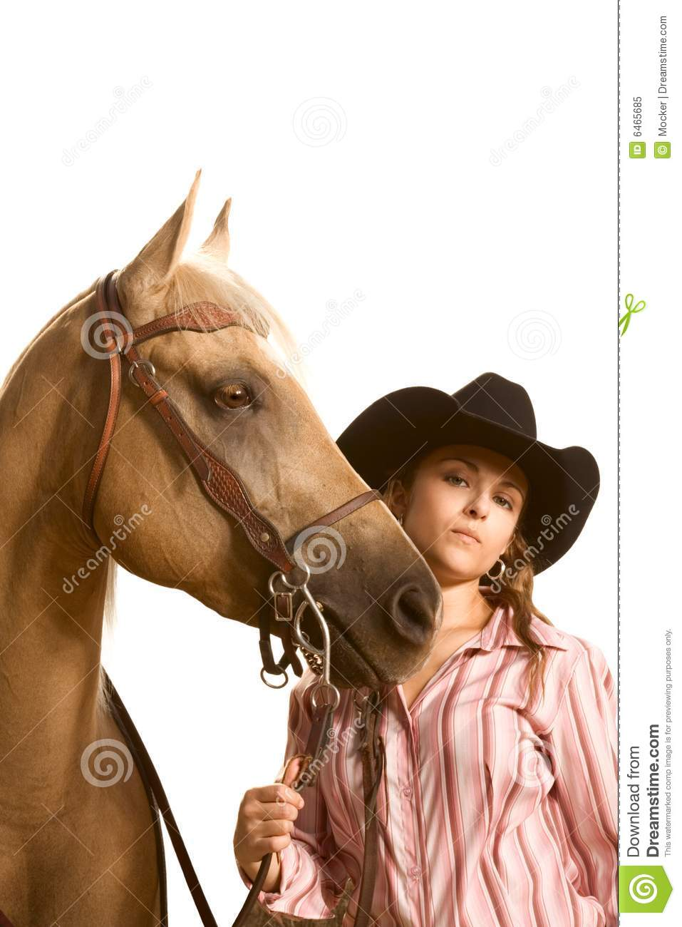 Bridle cowgirl hat her holding horse